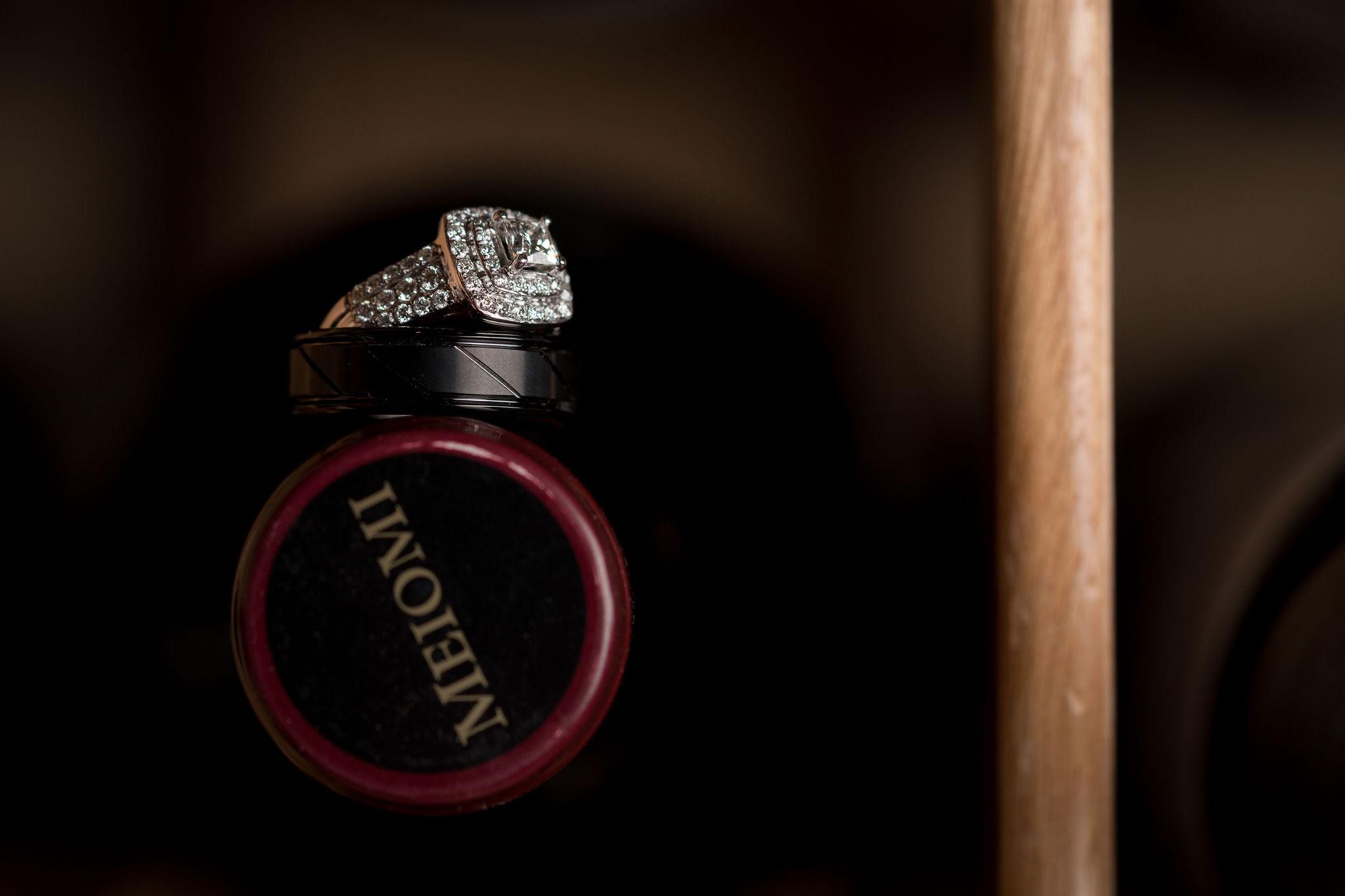 wedding ring in wine rack.