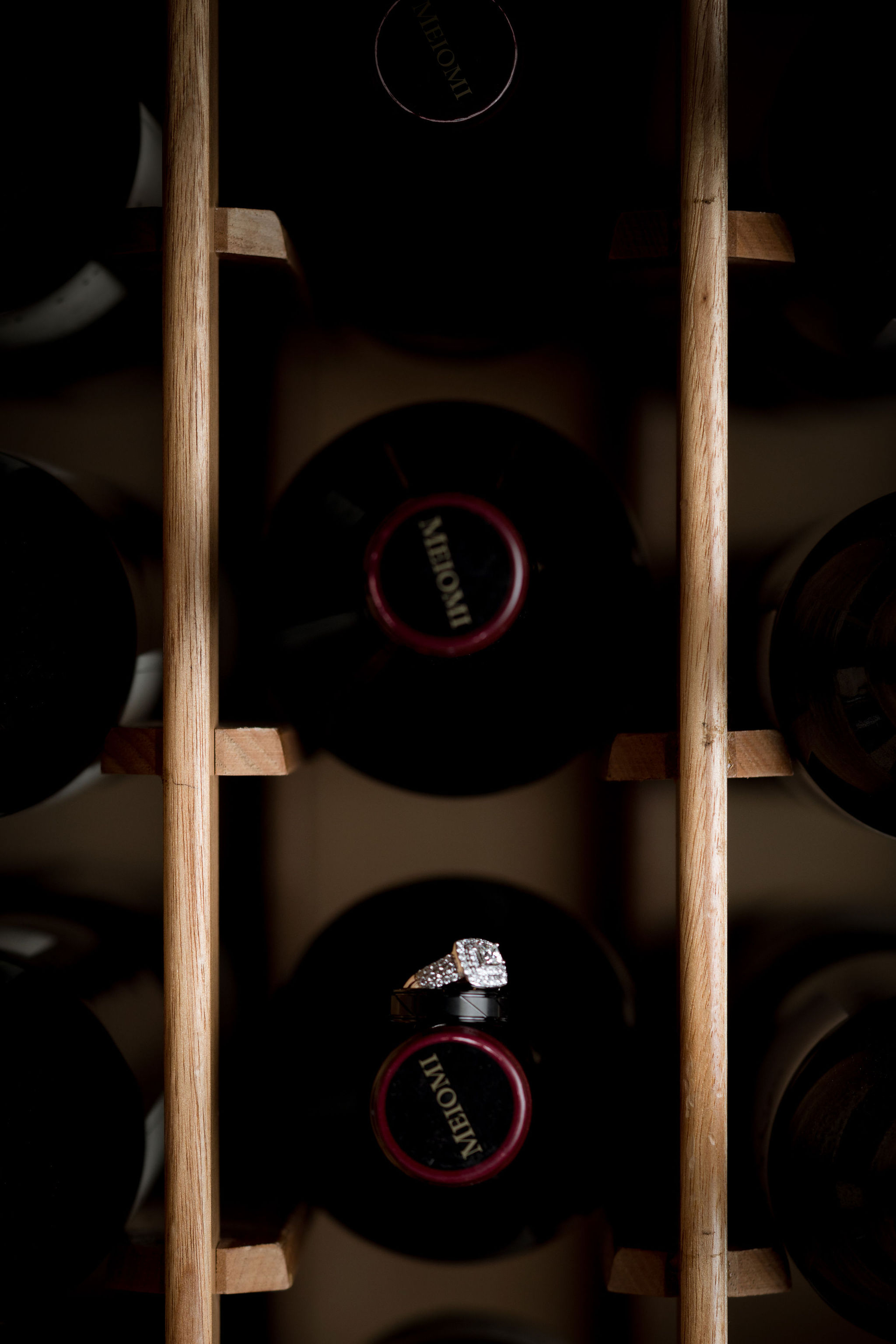wedding ring in wine rack at Sand Creek Country Club.