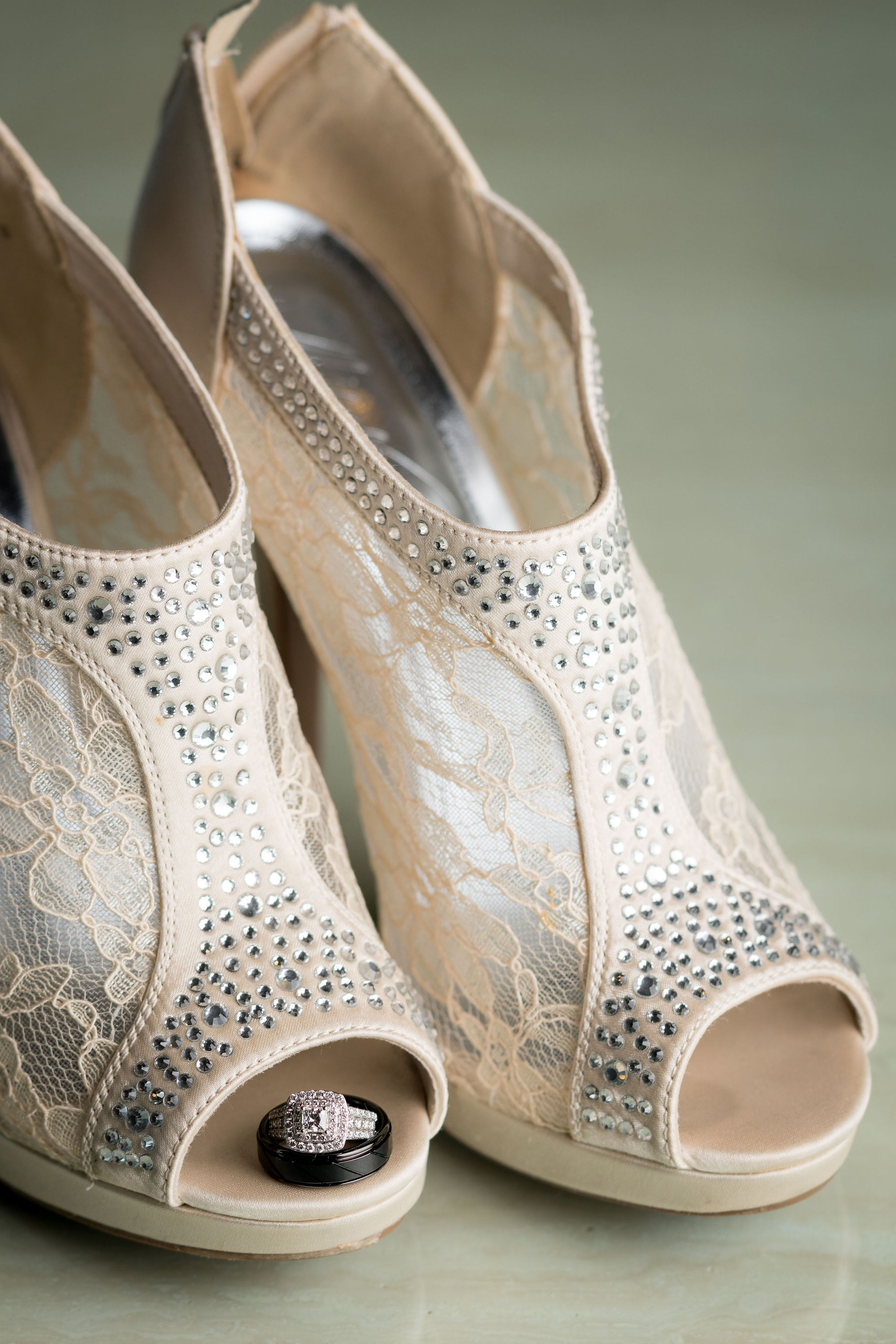 Wedding ring in bride's shoes for detail shot.