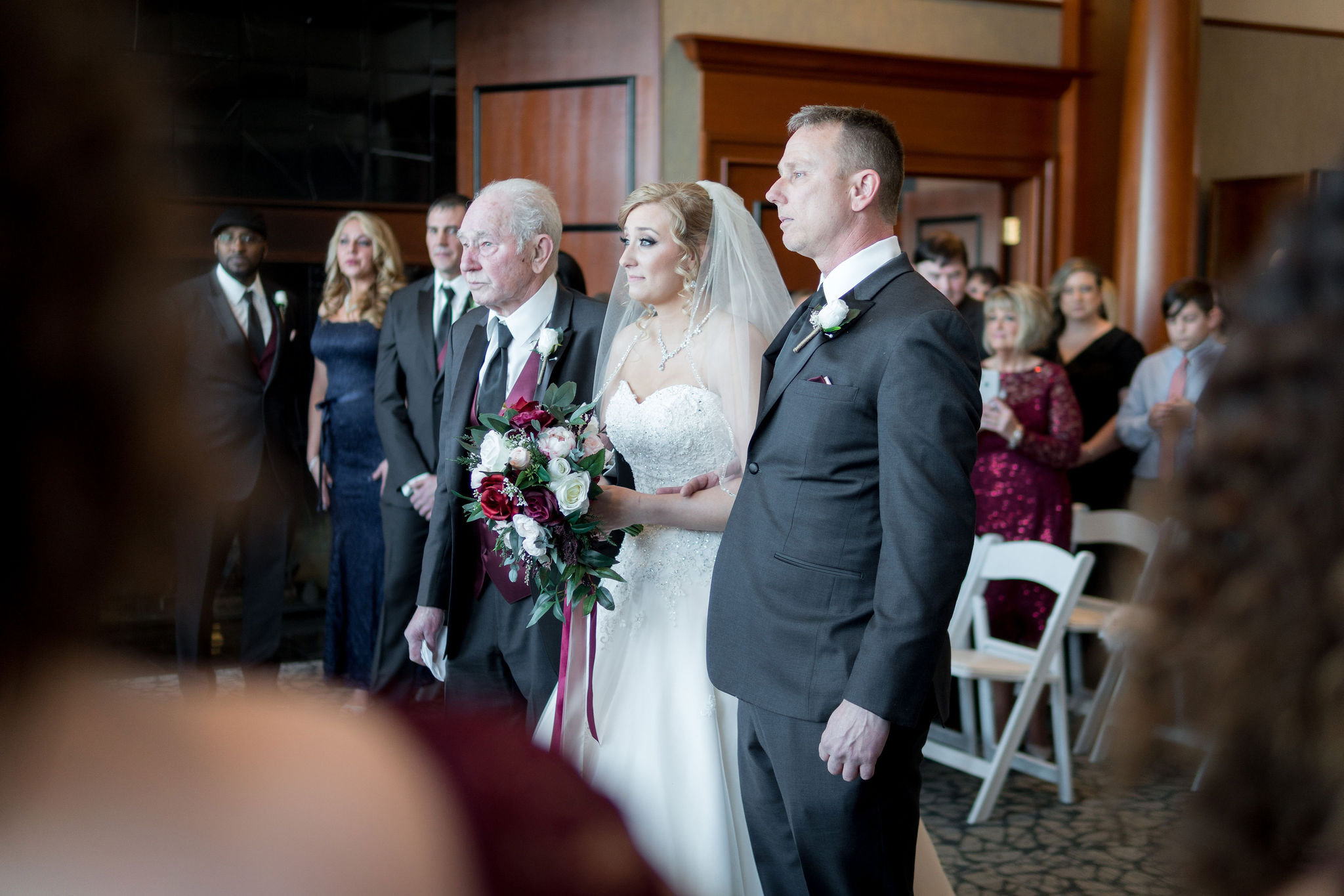 Bride walking down the aisle at Sand Creek Country Club