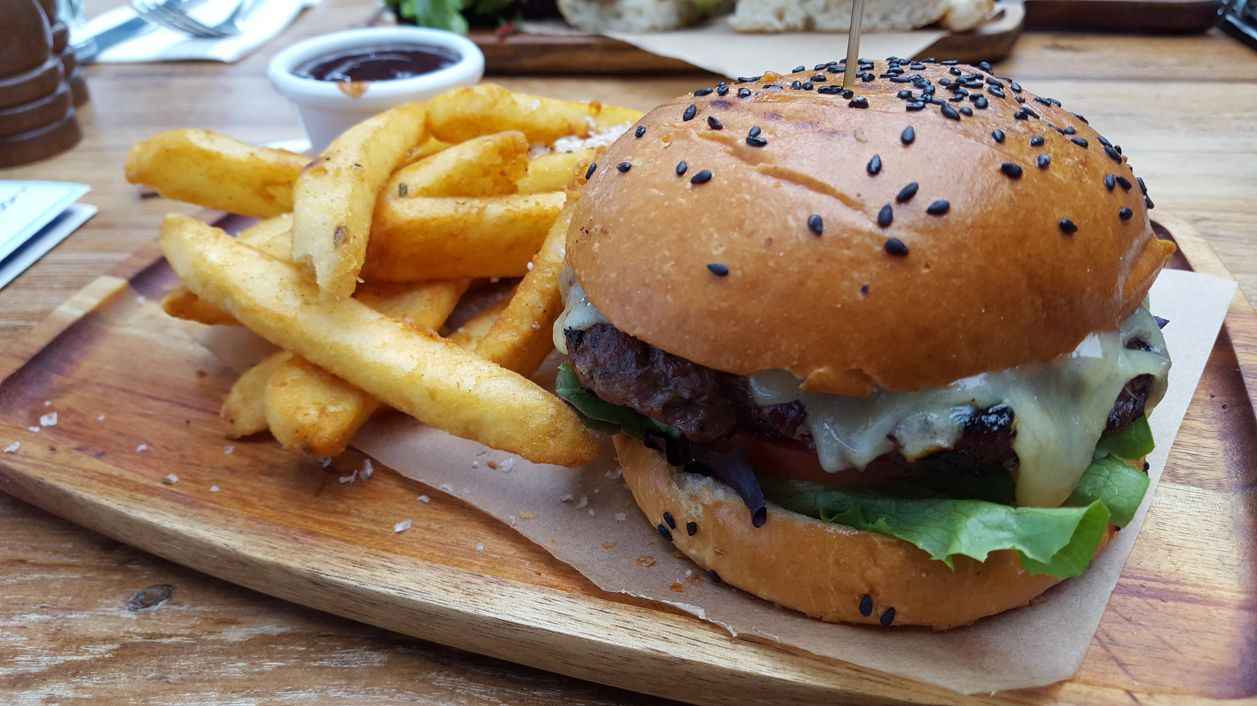 Despite my willingness to eat anything after 15 hours of airline food, this burger was put together beautifully.Complete with artisanal cutting board.  Harbour Bar & Kitchen