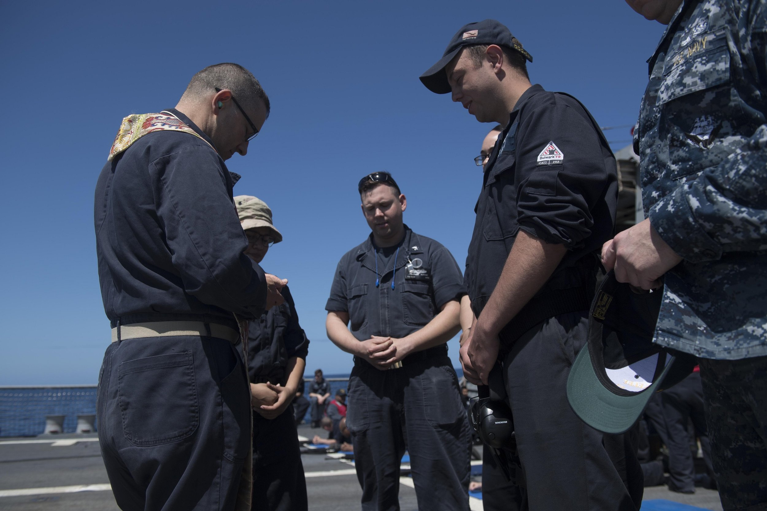 Chaplain Philip Webster - prays with sailors in the US Navy aboard the USS BULKELEY