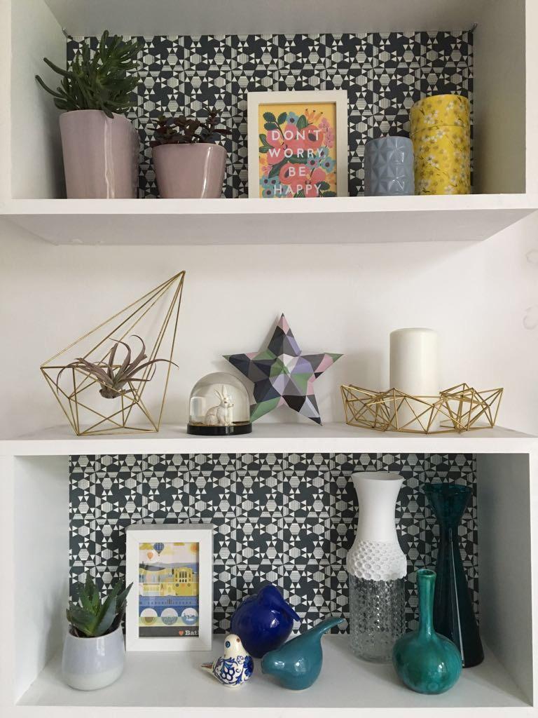 Papered shelf backs