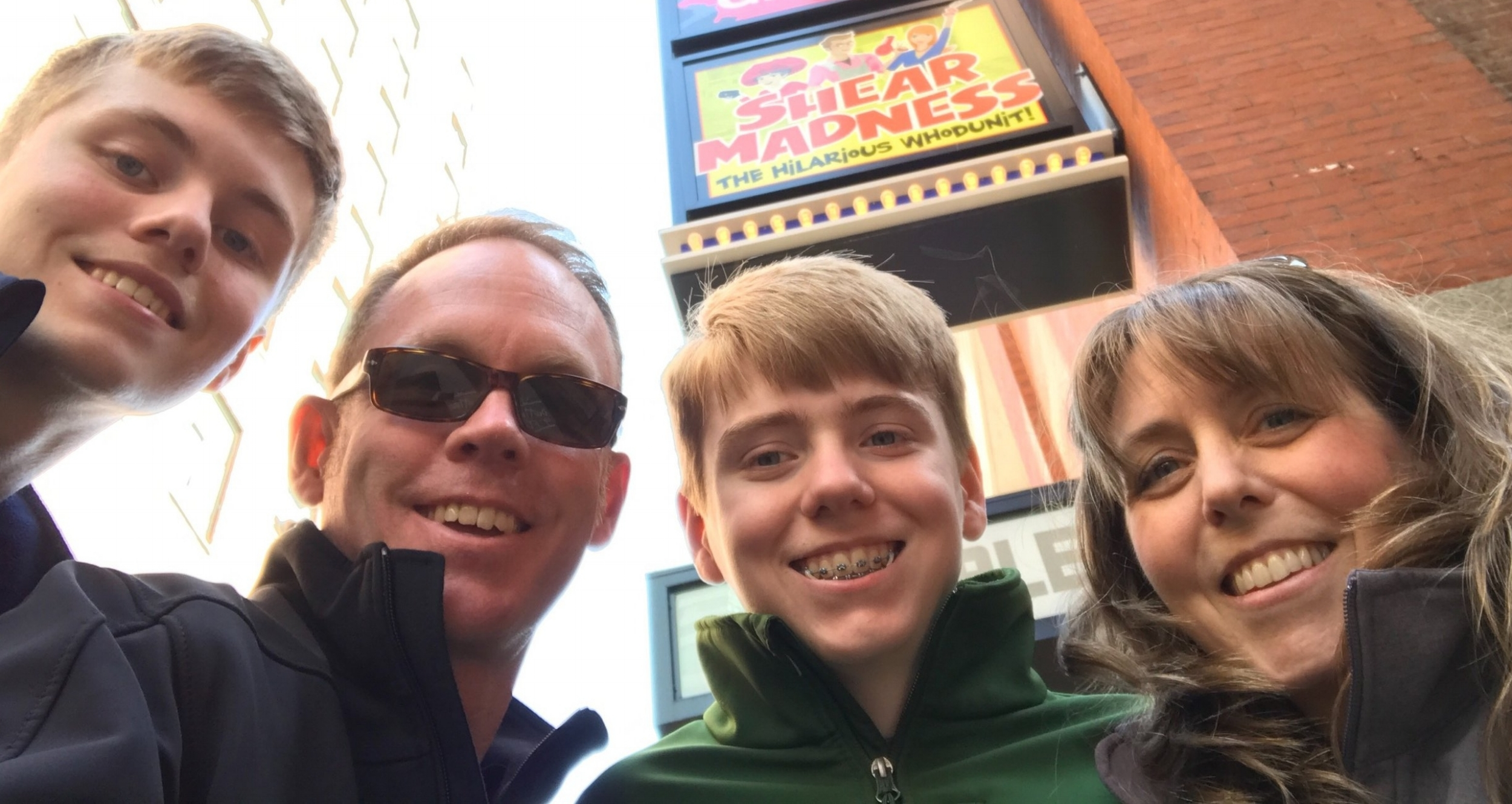 Pam Williams, Founder of  Connect the Dots Education Services , with her husband, Doug, and Twin sons, Nick and Chris in Boston's Theater District.