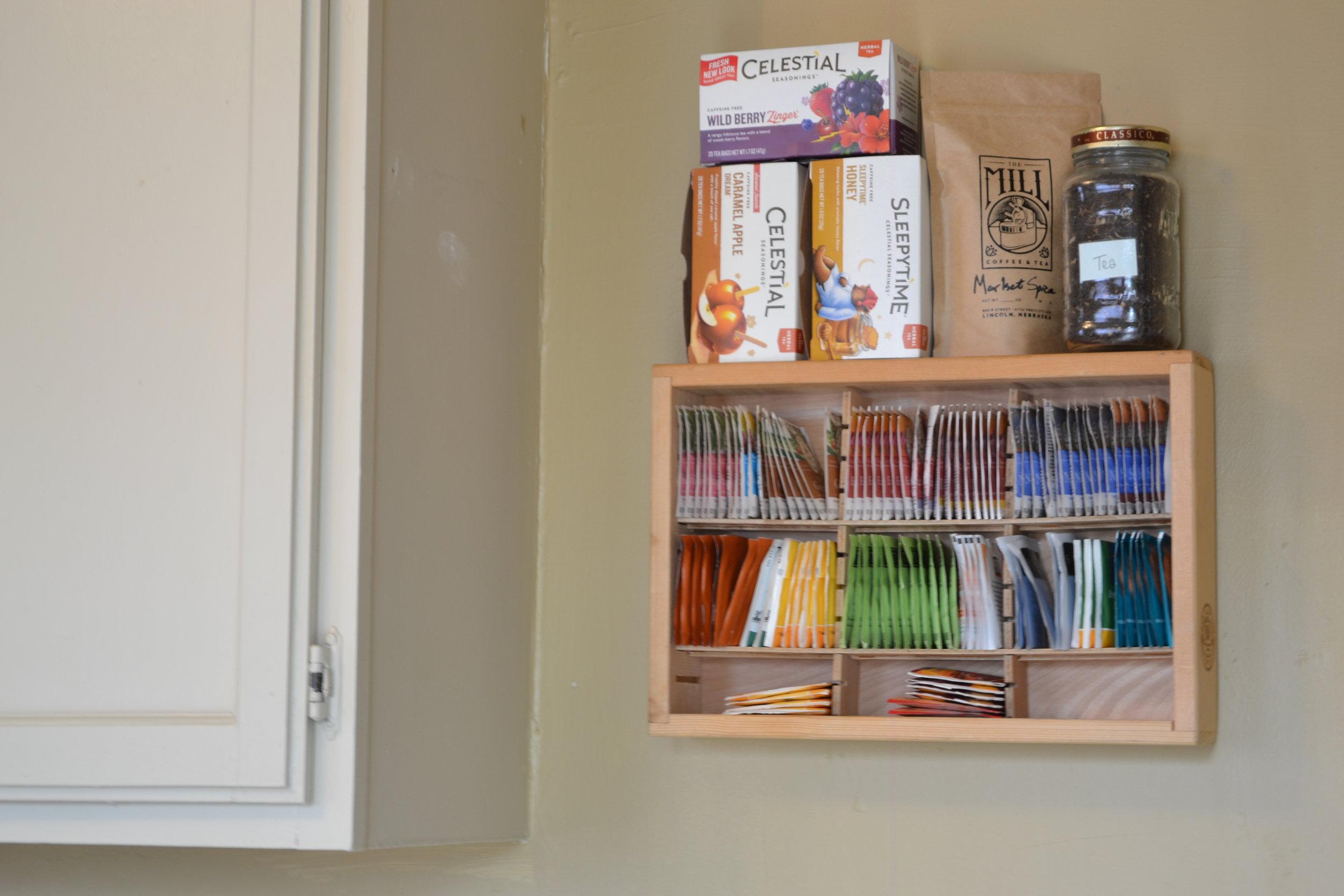 A repurposed cassette tape rack as a tea shelf.