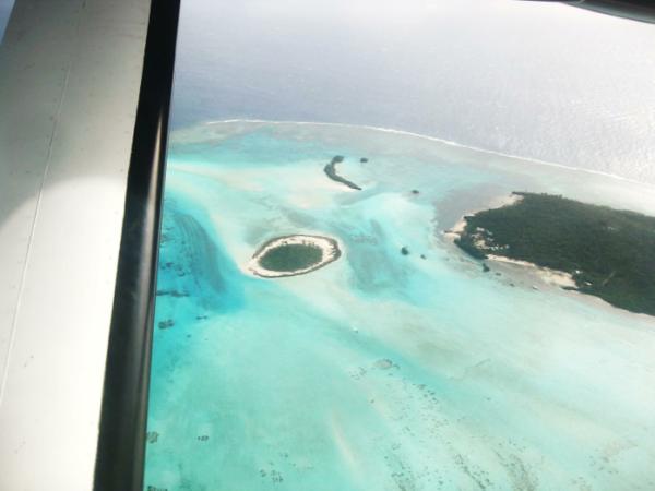 Flying over Kaibu Island. Photo © Helen Sykes
