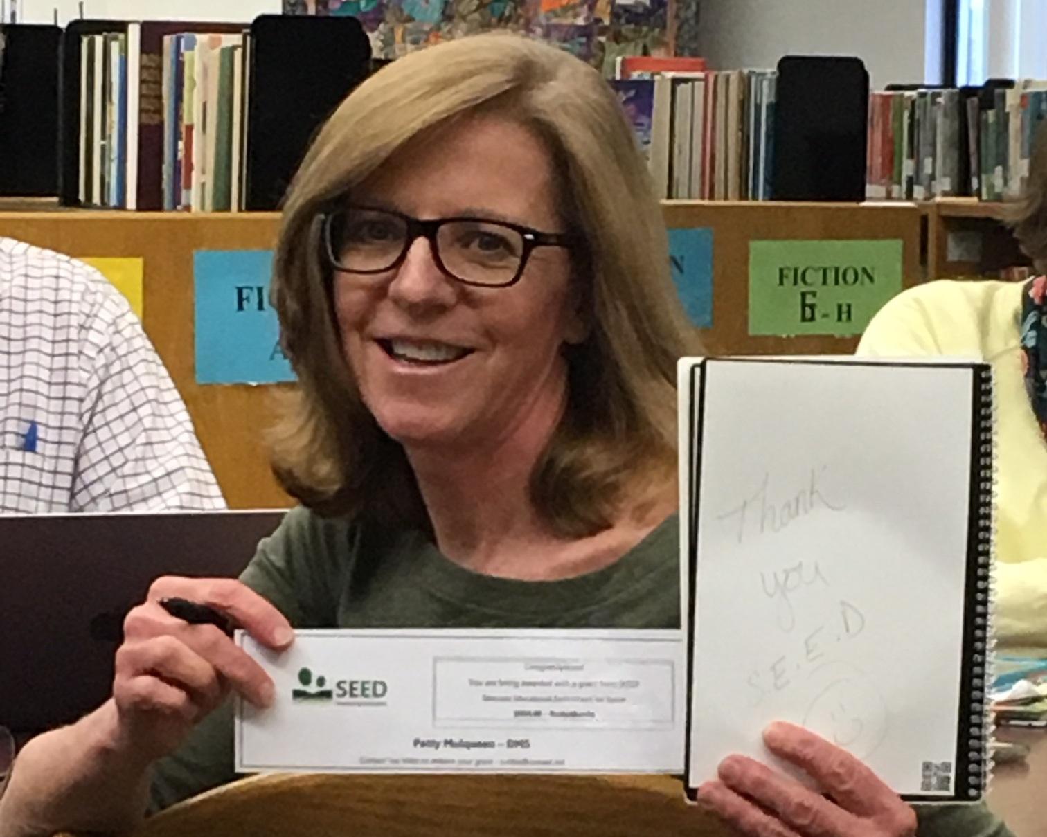 Math teacher Patty Mulqueen provided 2 dozen Rocketbooks for DMS students.