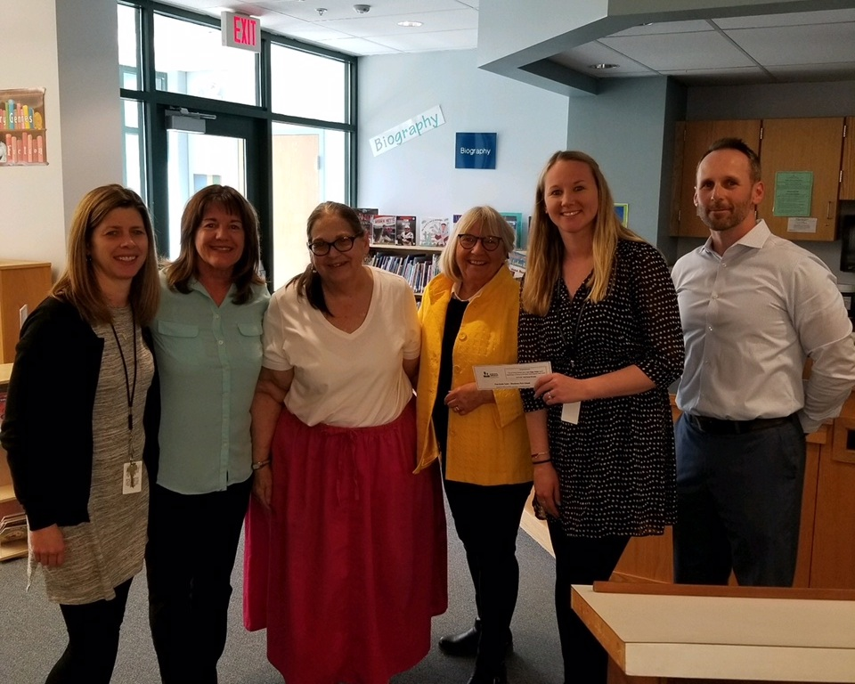 Woodman Park School first grade team accepts SEED grant to purchase literacy curriculum.