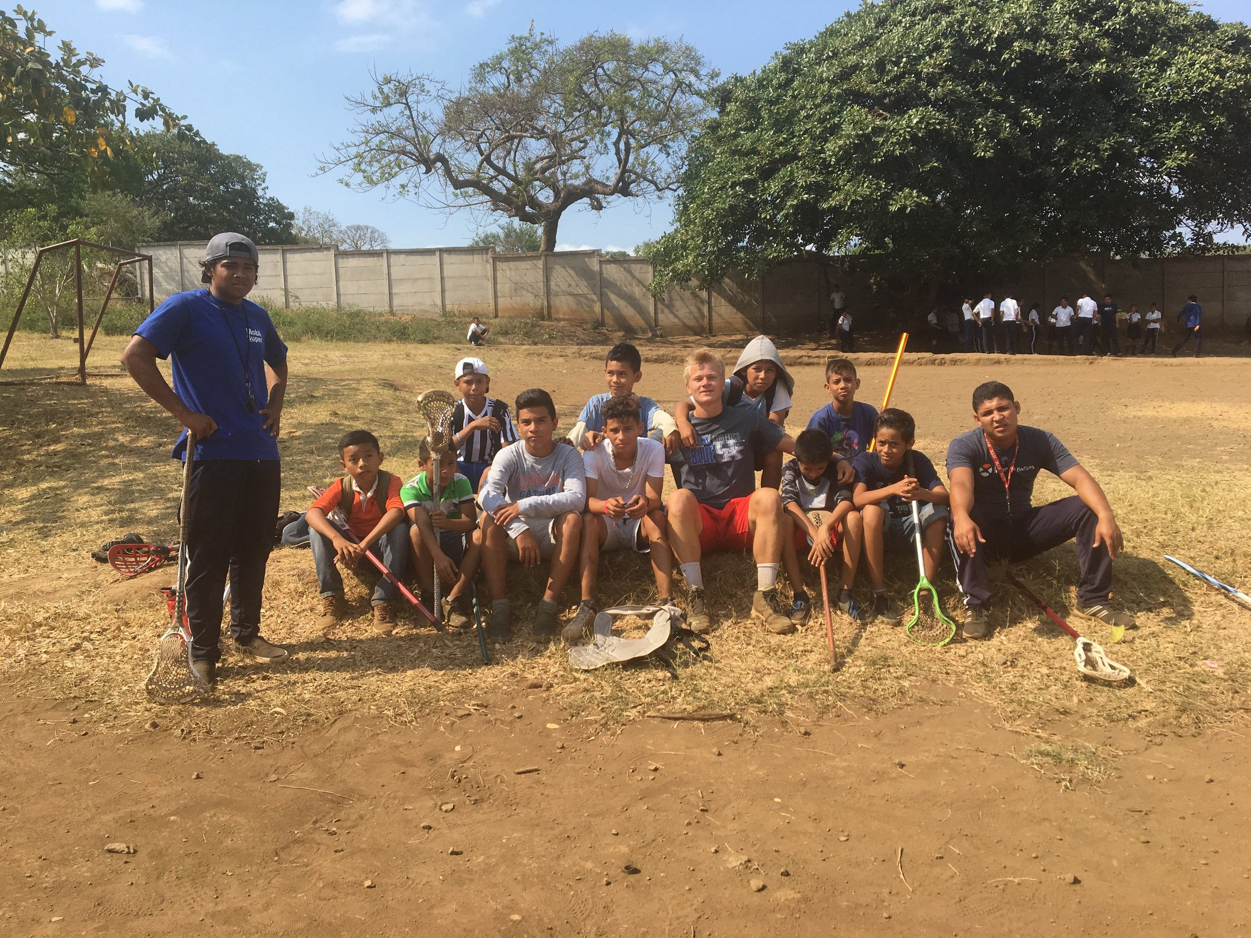 Coaches Freddy and David with PD, Lou, and Chiqui beginner players at morning lacrosse practice in Nicaragua.