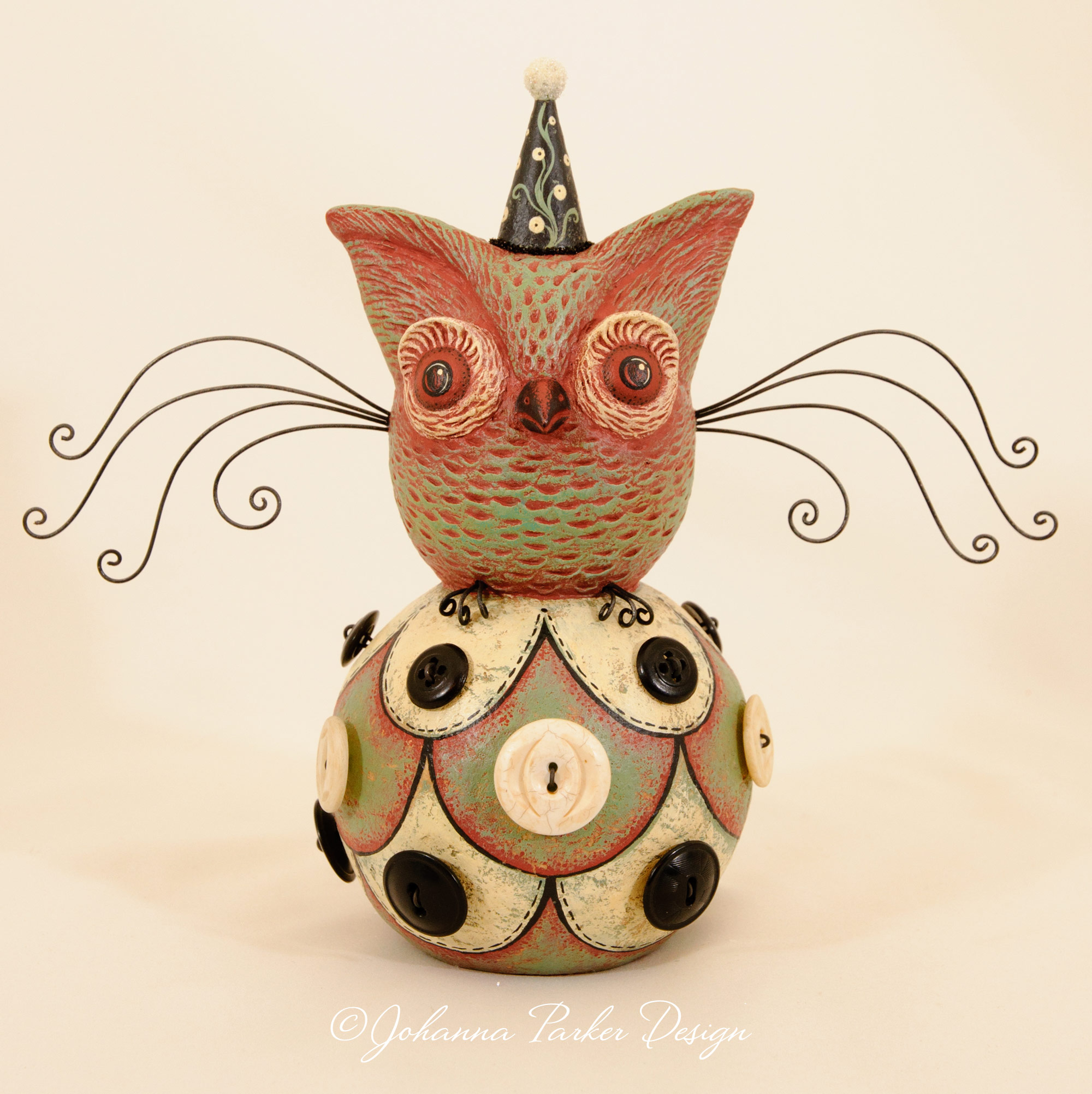 Button ball perched owl
