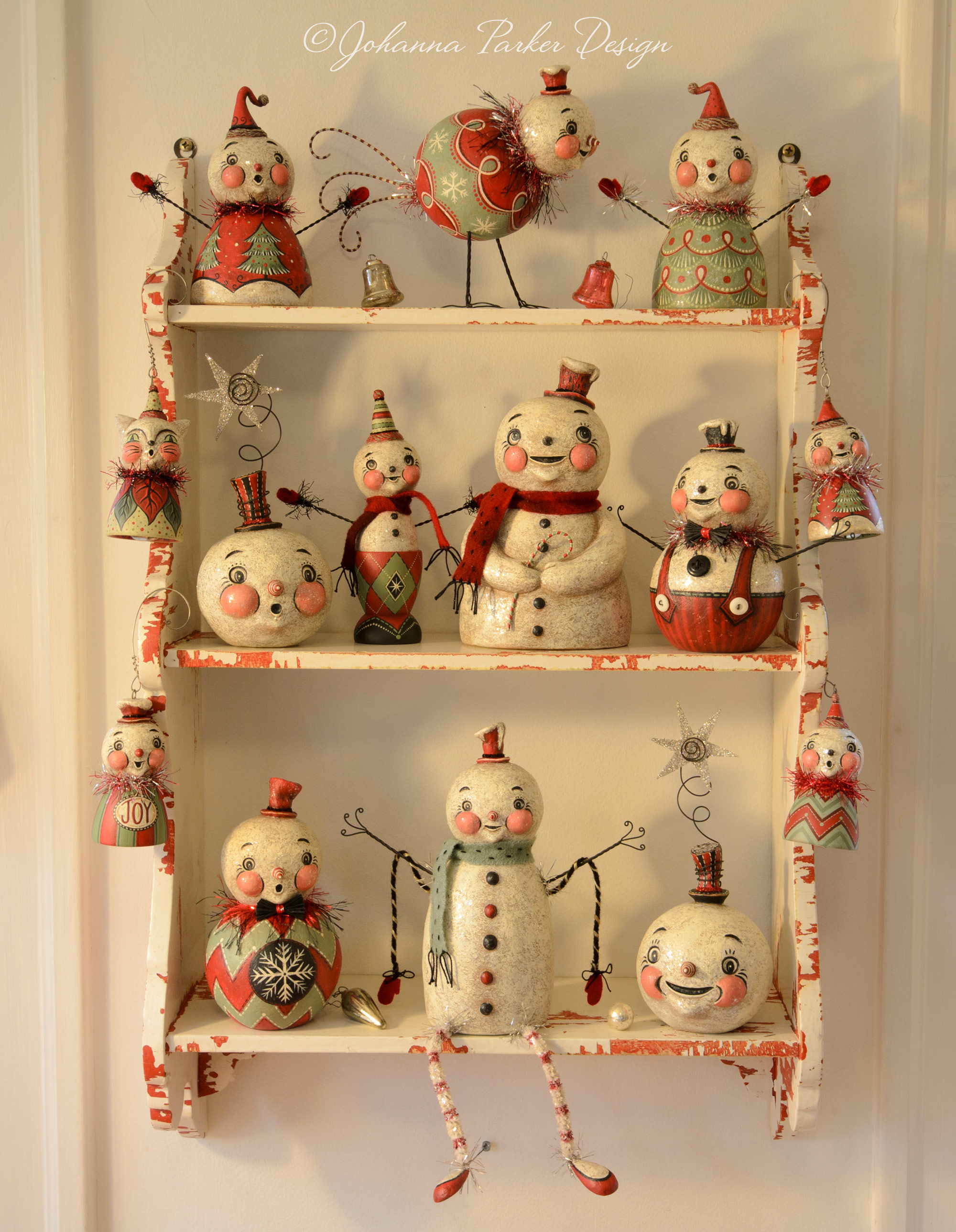 Holiday folk art shelf collection
