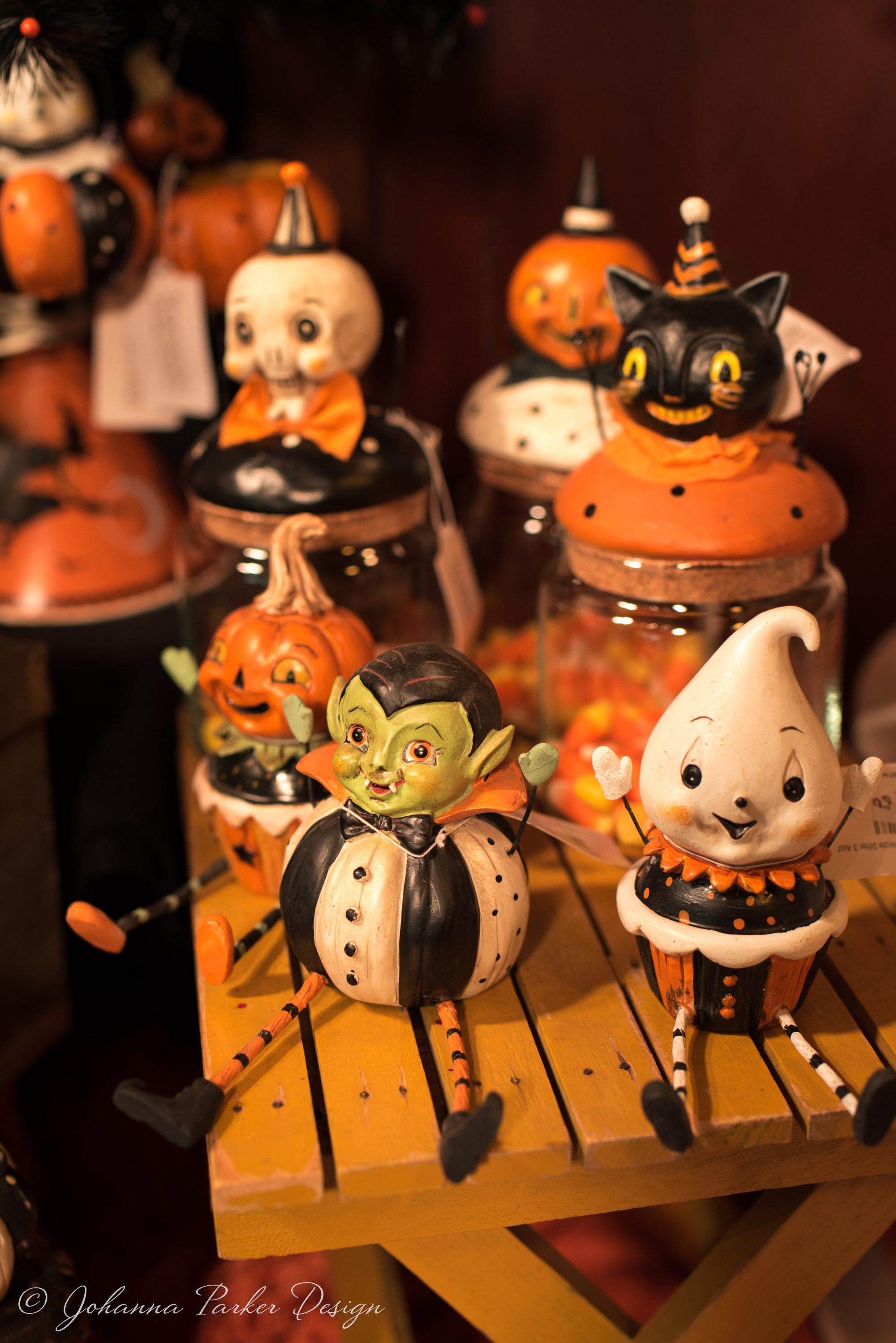 Glass candy jars with candy corn pair sweetly with their shelf sitter buddies...