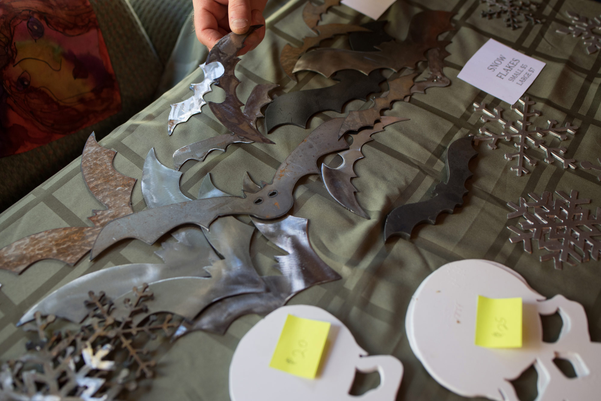 A variety of snowflakes, skulls & bats were scattered across Robert Hickler's table...