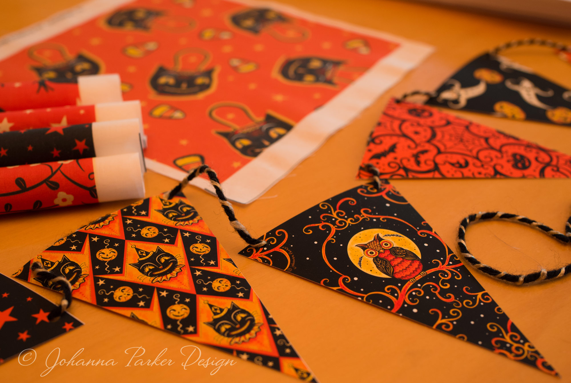 This photo shows a glimpse at one of my   Printable Halloween Pennant Garlands.   The same pattern work is featured on various designs in my   Spoonflower Shop   too.