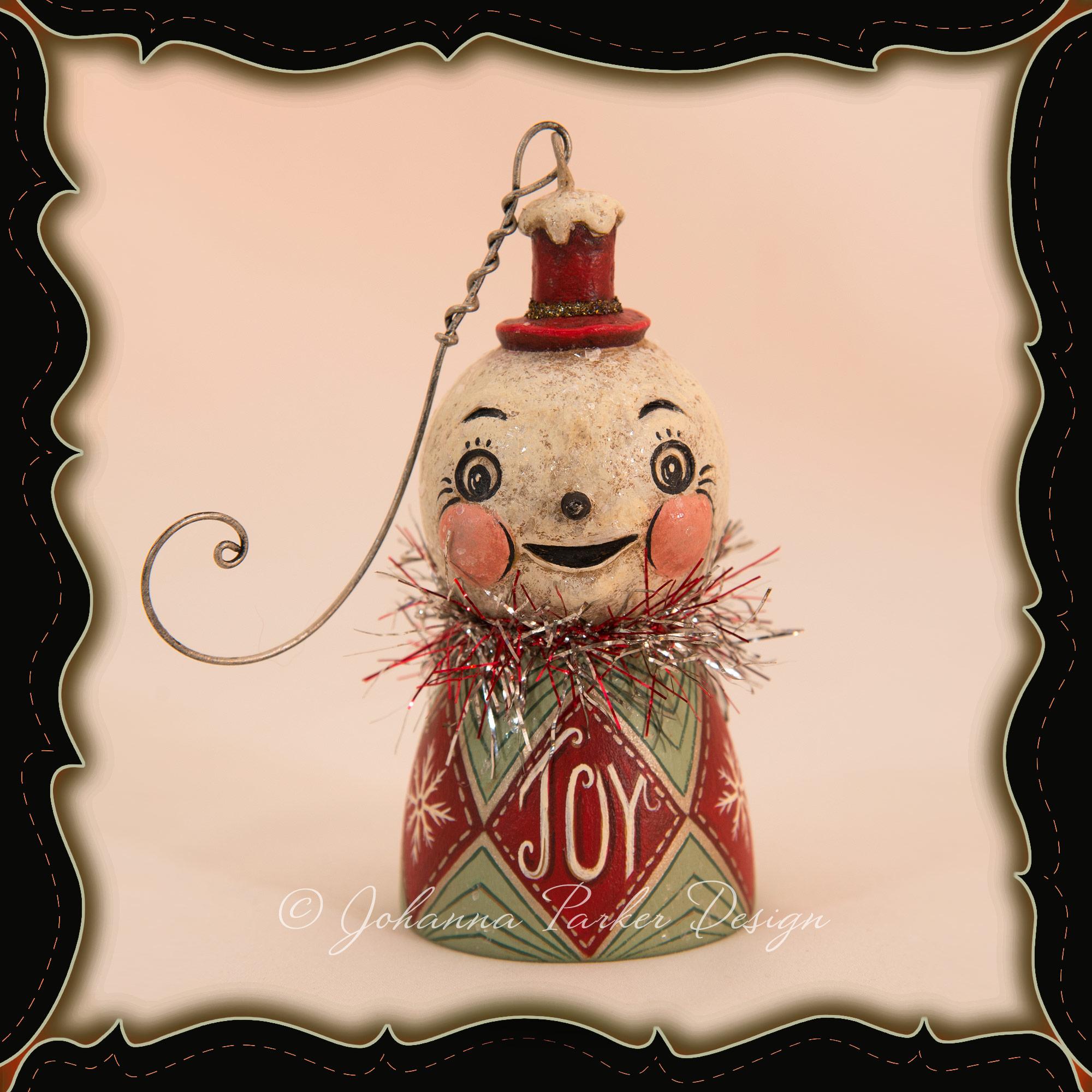 Johanna-Parker-Joy-Snowman-Ornament-Bell-framed.jpg