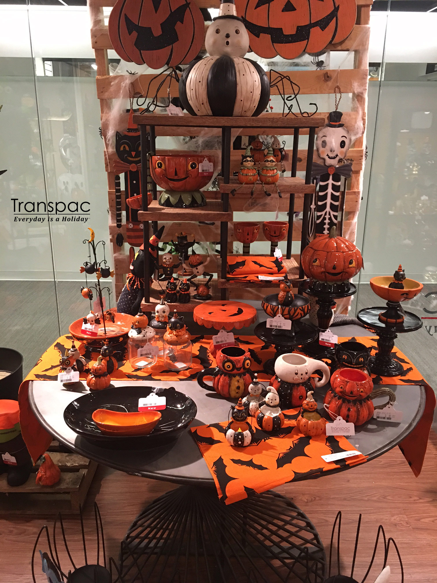 Quick snap from my January 2018 Halloween display in Transpac Import's Atlanta Showroom. I am not involved in this phase of the design process, so I cross my fingers that the displays will be eye-catching.The majority of the items grouped together here are my designs, minus the textiles and the large jack-o'-lanterns hovering over the scene. My Black Cat Mug is in the mix, albeit a bit tricky to see from this angle.