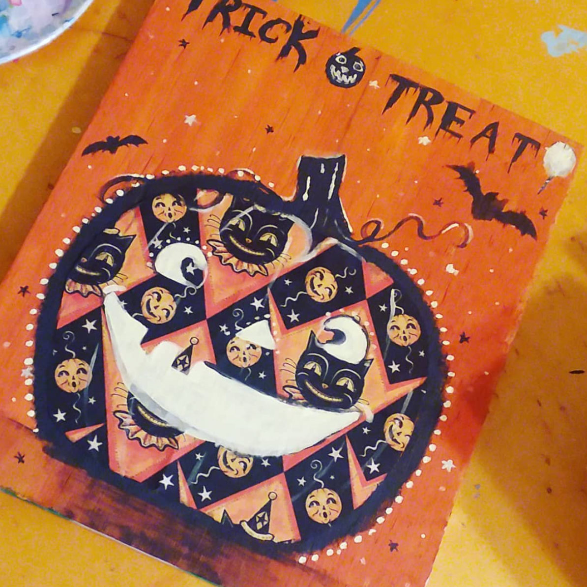 "Mixed Media Halloween decor handmade by @stephaniewillimon (on Instagram) using Johanna Parker Halloween fabric from Spoonflower.  GET: ""Grinning Black Cat & Jacks"""