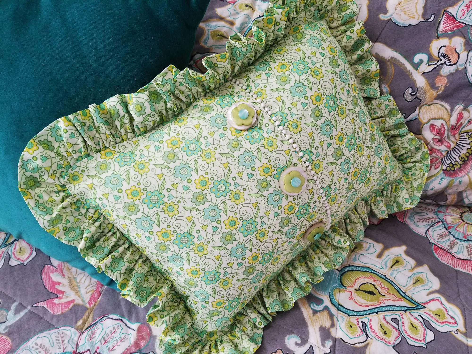 "Ruffled flower patch pillow handmade by @ben.ally.mom (on Instagram) using Johanna Parker floral fabric from Spoonflower.  GET: ""Flower Patch Yellow Green small"""