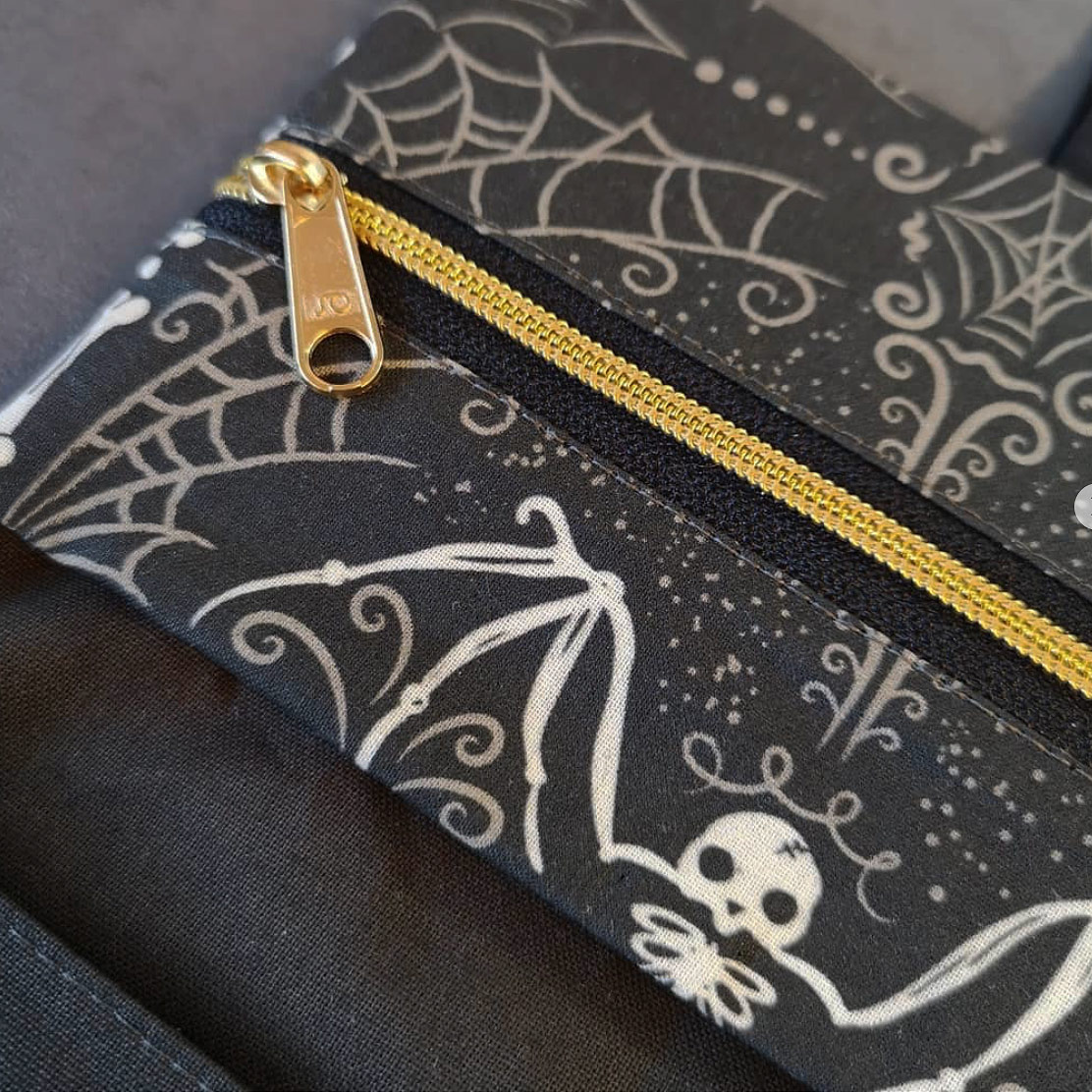 "Spooky Bat Skeleton purse pouch by @vroni_makeroni (on Instagram) using Johanna Parker Design Halloween fabric from Spoonflower.  GET: ""Spooky Bat Skeleton"""