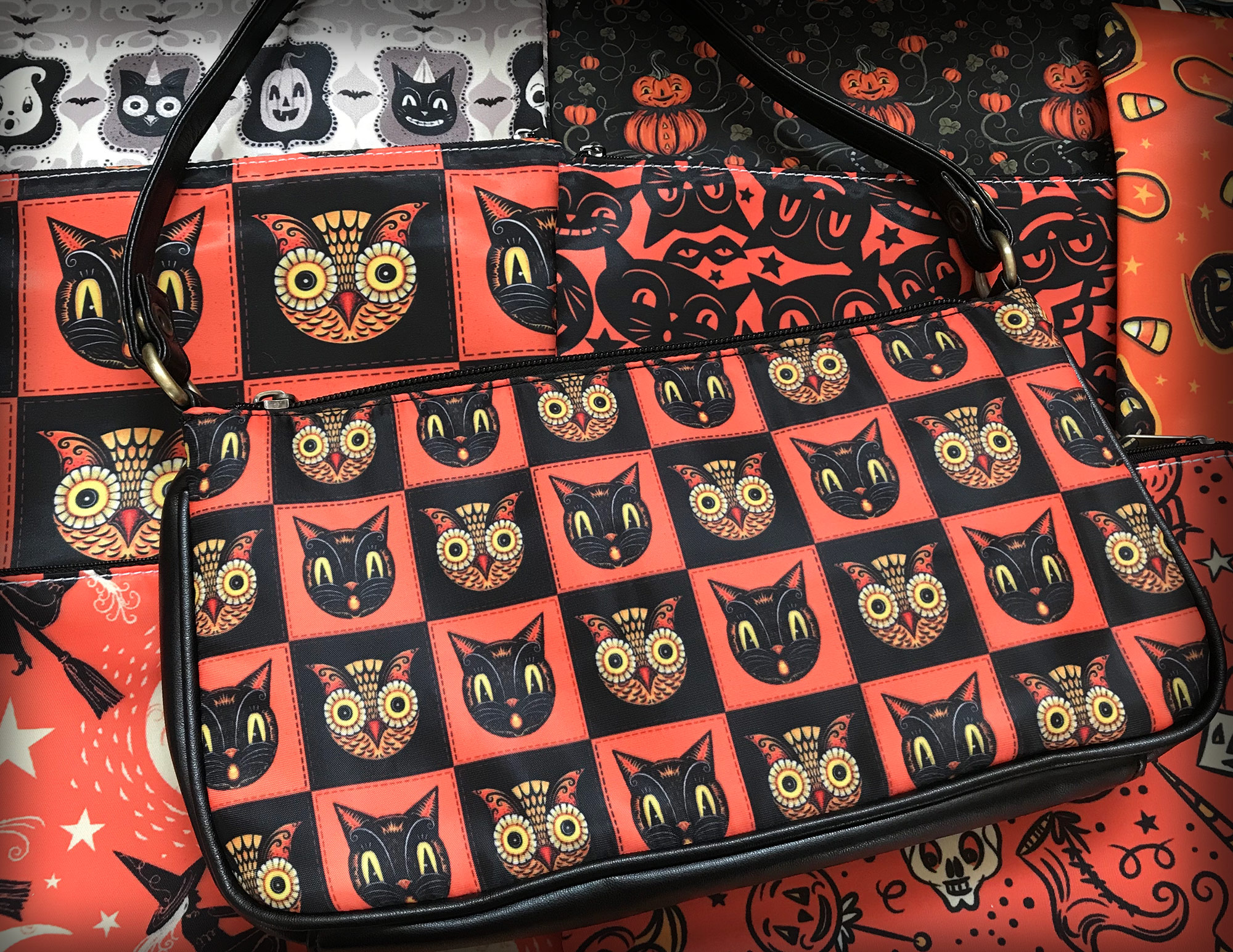 Enjoy Johanna's classic Black Cat & Owl checkerboard design on a clutch with many more spooktacular designs to choose from!