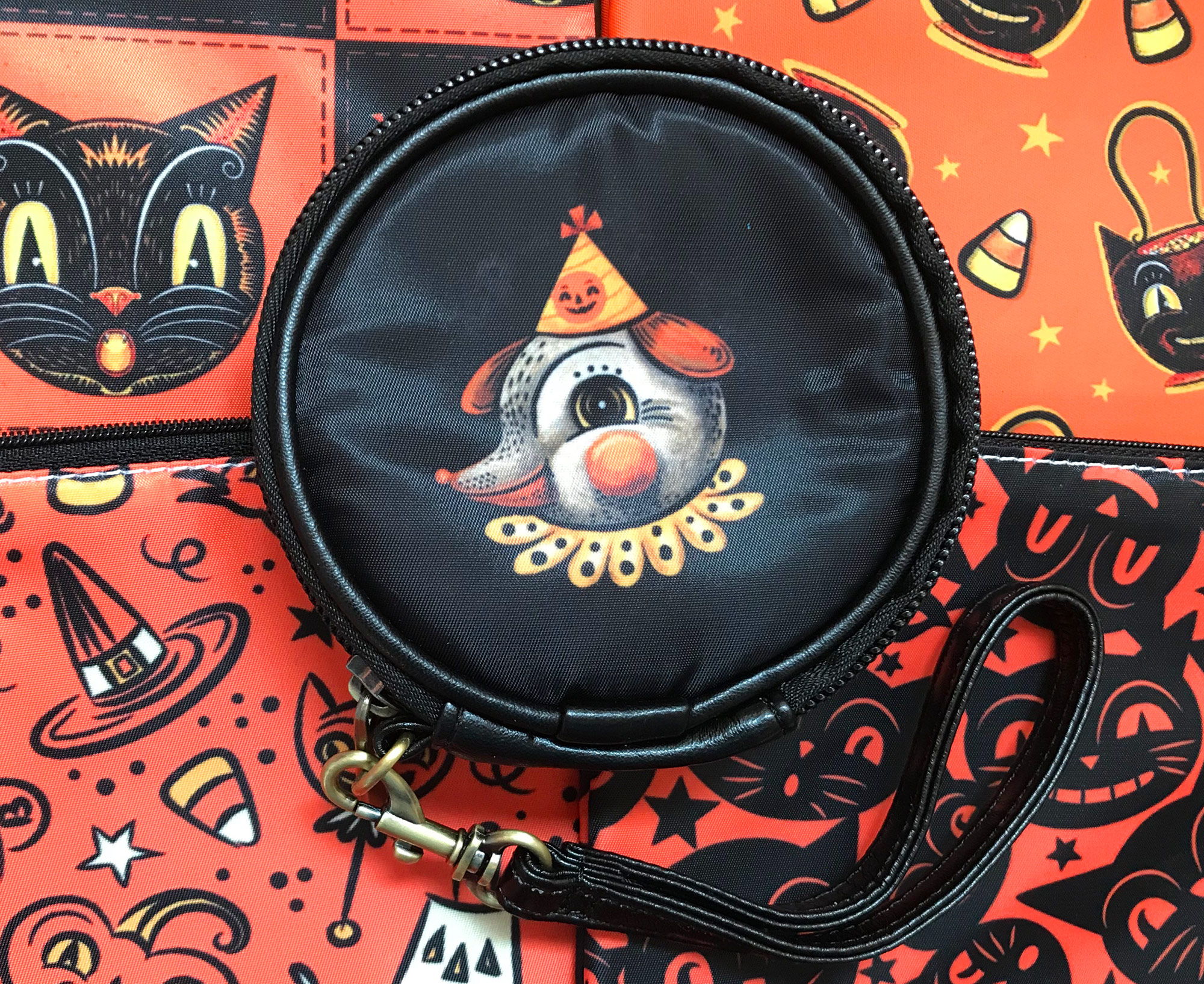 Double-sided round zipper pouches feature different faces from Johanna's family of illustrated characters. Fill with your makeup essentials, coins or whatever you wish!