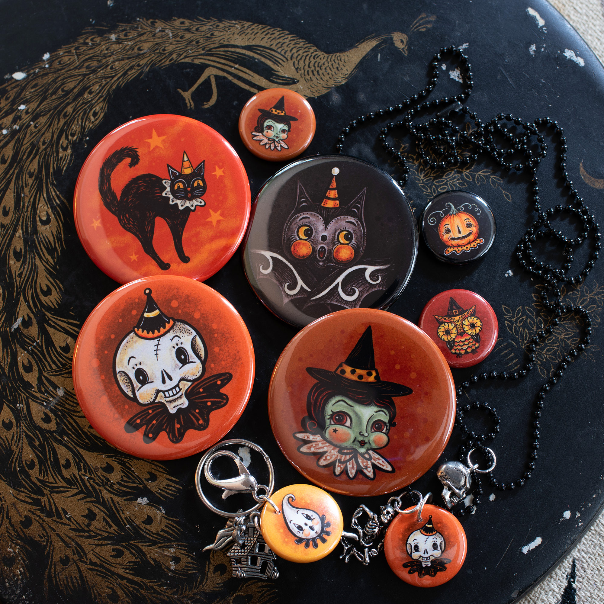 Illustrated Buttons in various size, serve as playful pins, necklaces and key chains…