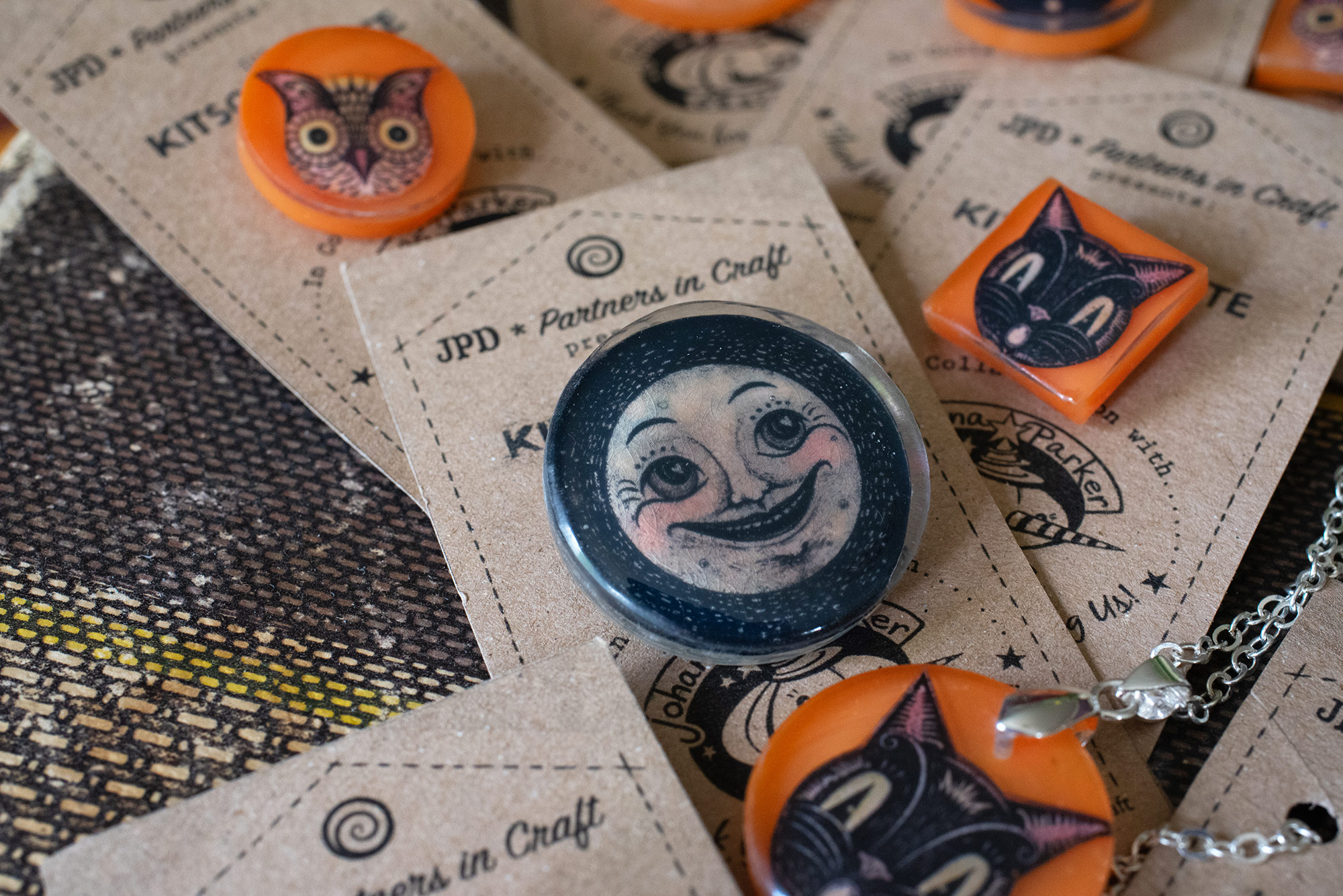 Handmade Halloween jewelry made from Johanna's illustrations and Kitty's magic resin blend