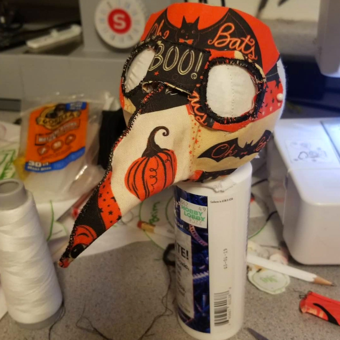 Halloween Plague Mask by  @CottonStemPrims (on Instagram) using Johanna Parker Design Halloween fabric from Spoonflower.  GET: Vintage Halloween Patchwork large