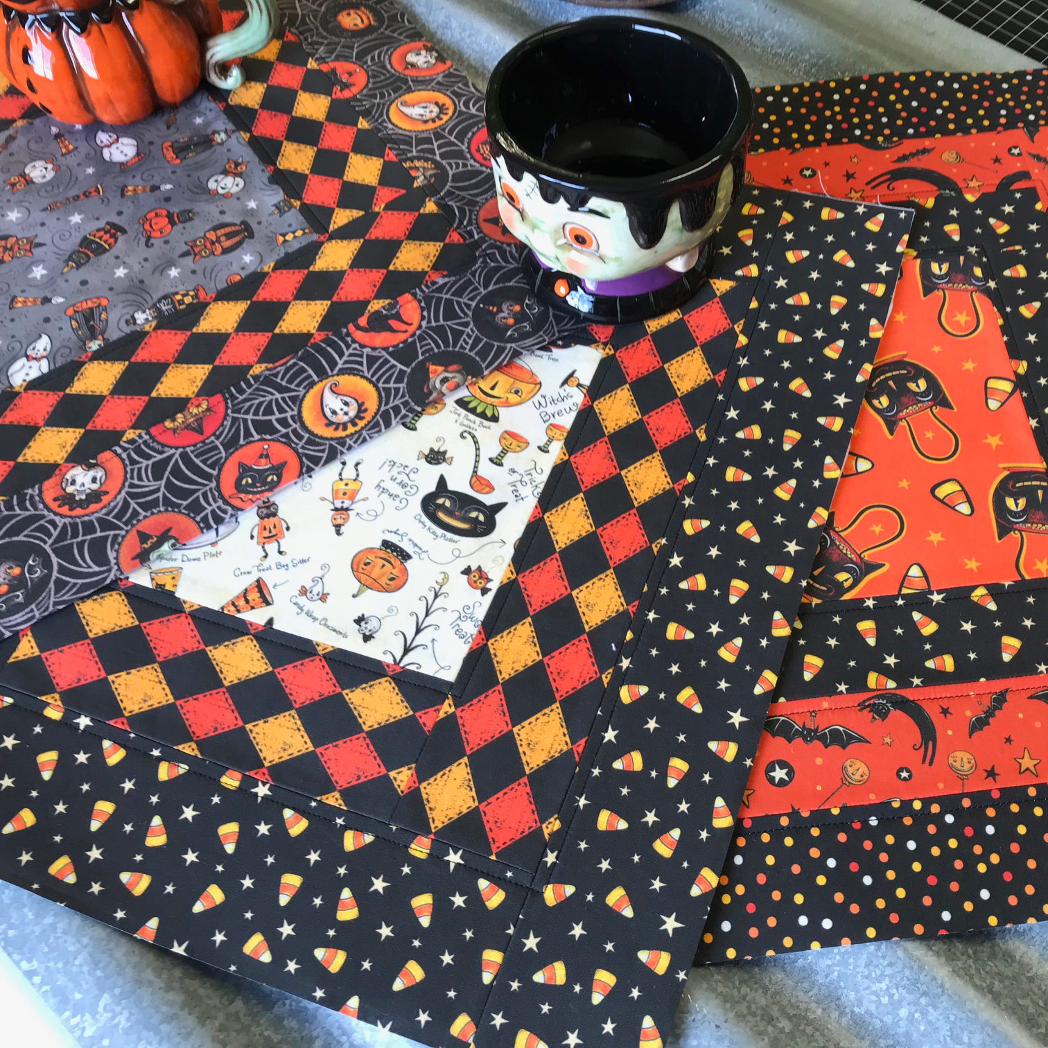 Halloween Table Toppers by @roadsidecottage (on Instagram) using Johanna Parker Design Halloween fabric from Spoonflower.