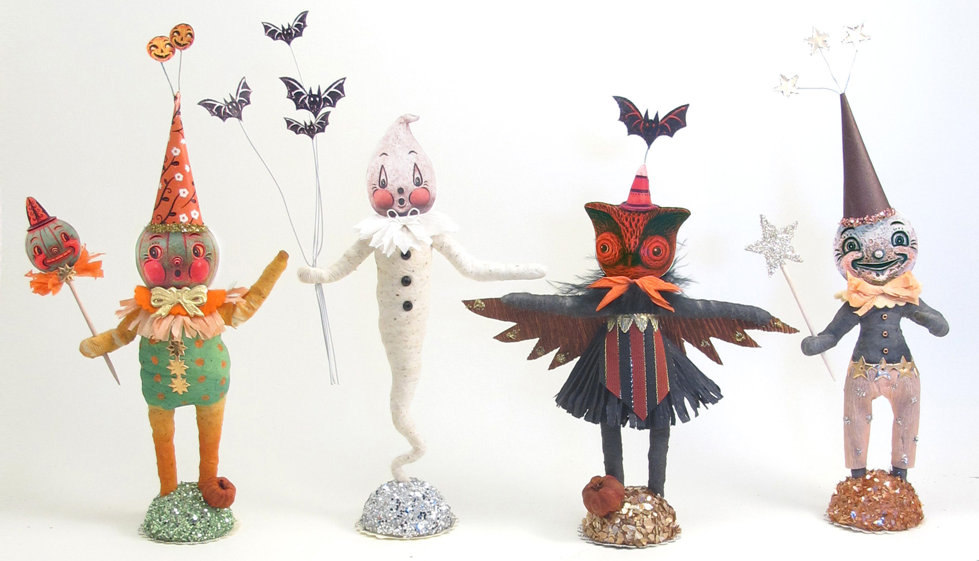 A classic green jack-o'-lantern, ghost, owl and moon make for a playful family of characters! Each is handmade from Vintage by Crystal, and they do look spooktacular, clustered in groups!