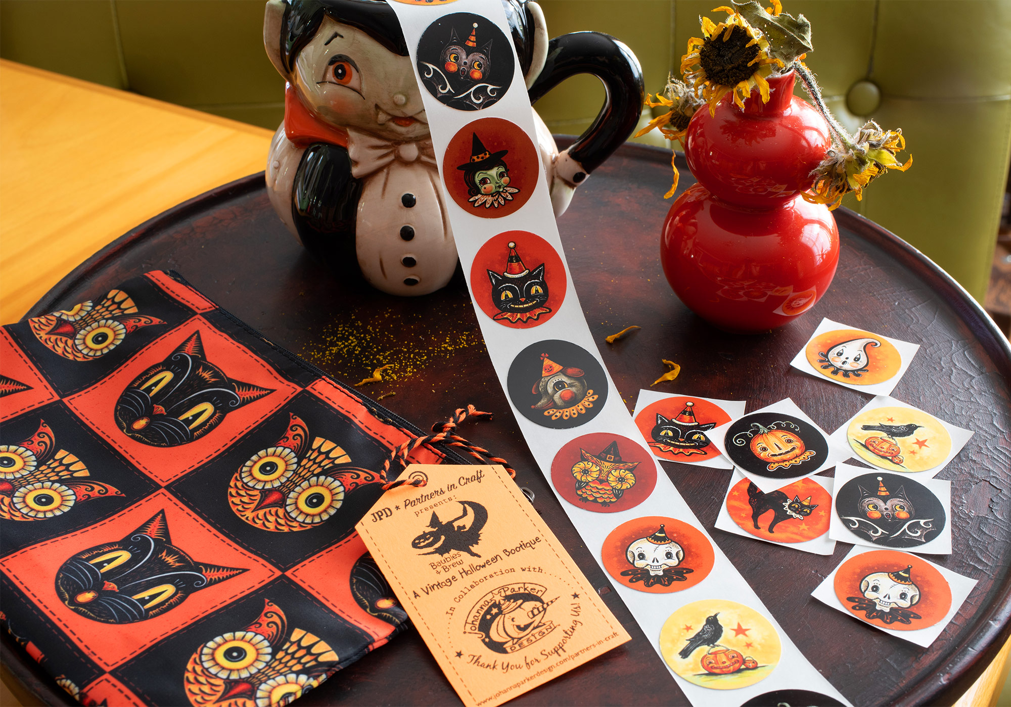 Collect & Craft with Johanna's Halloween stickers featuring her illustrations. Available thru the Vintage Halloween Store collaboration, order these in sets of 10 unique designs. Choose your favorite Halloween zipper pouch to keep them in! What a fun gift for any  JPD Halloween fan!