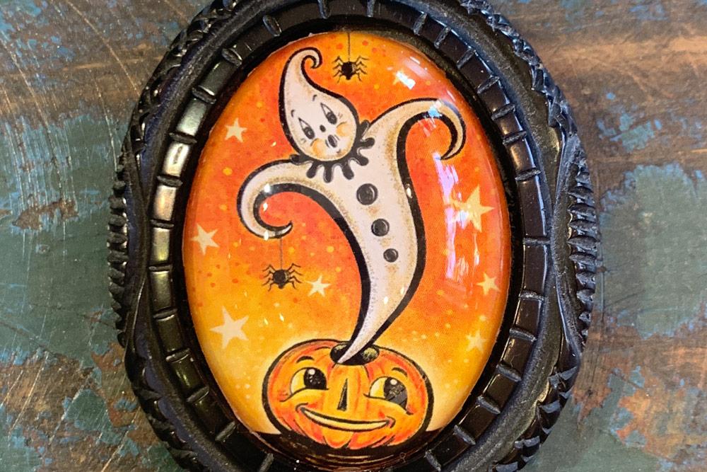 "Johanna's ""Ghost Genie"" framed in Caramia's vintage Bakelite styled bezel…"
