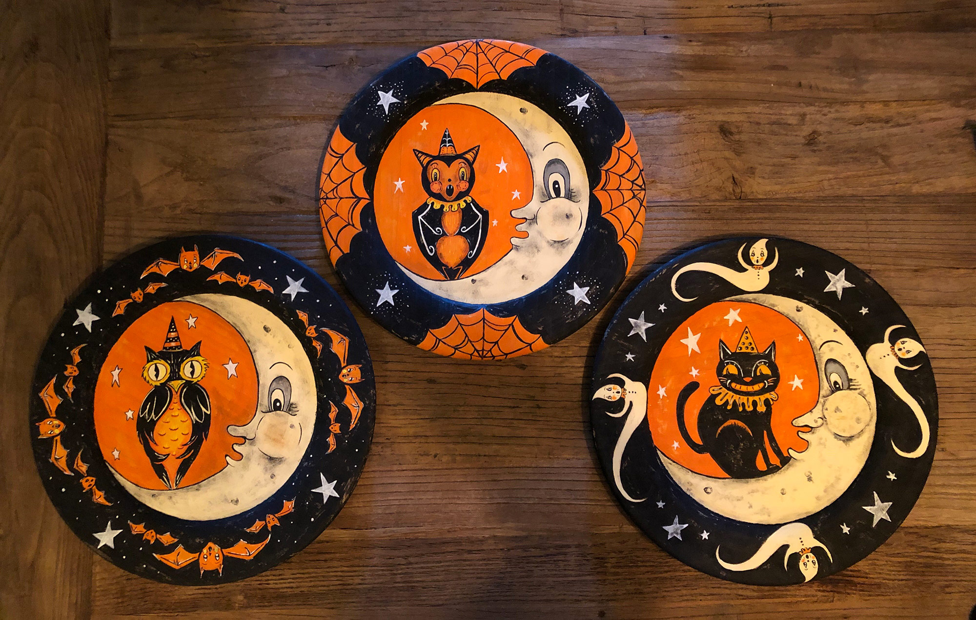 A trio of folksy Halloween art plates composed and painted by Crystal, featuring Johanna's classic motifs…