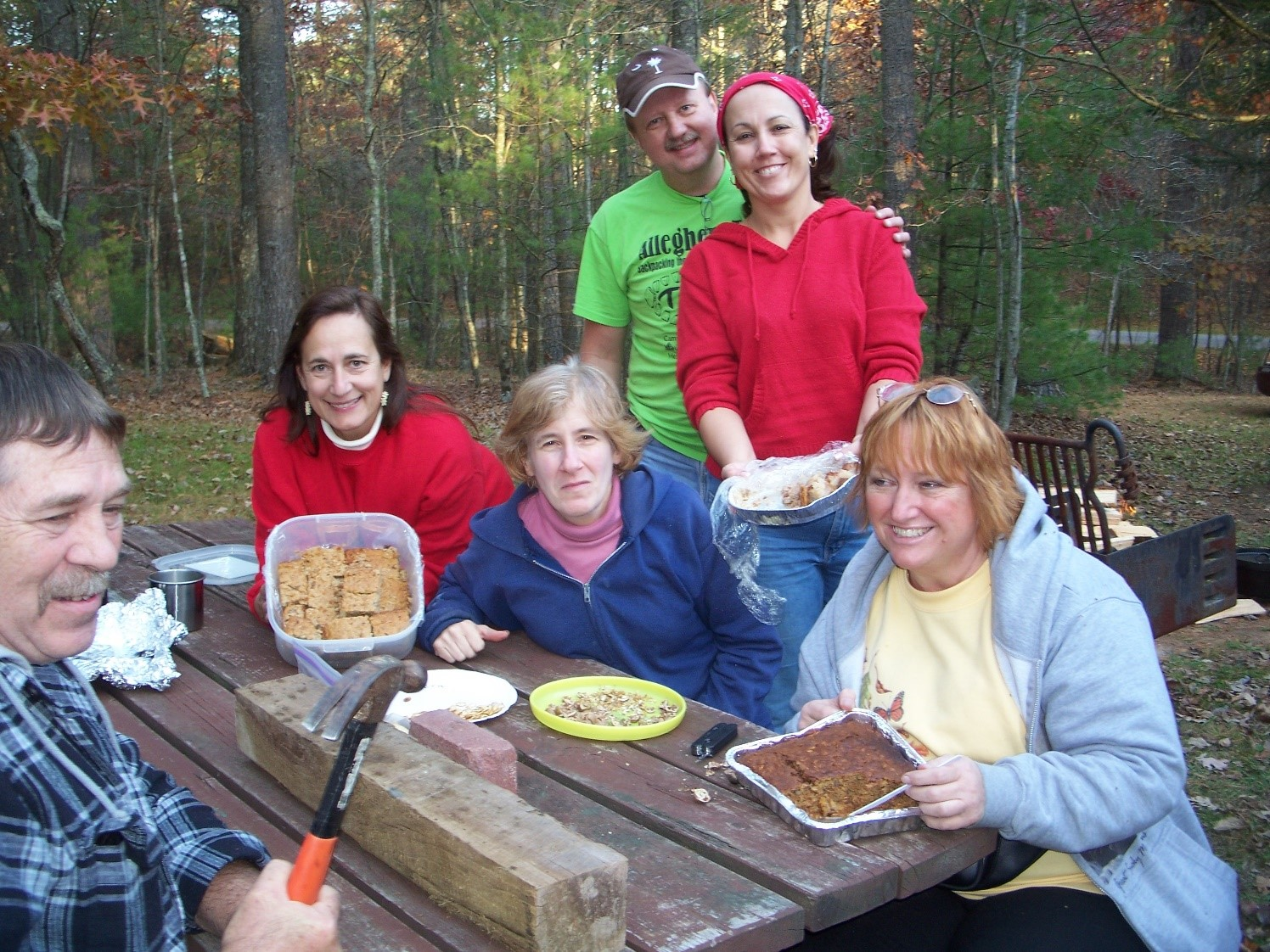 Friends show-off wild foods after cracking Hickory nuts. Doug Wood photo.
