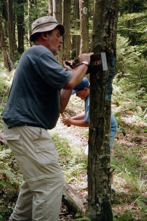 Lee Reger & grandson Jacob Kisella erecting Allegheny Trail signs during W5 in 2003. Doug Wood photo.