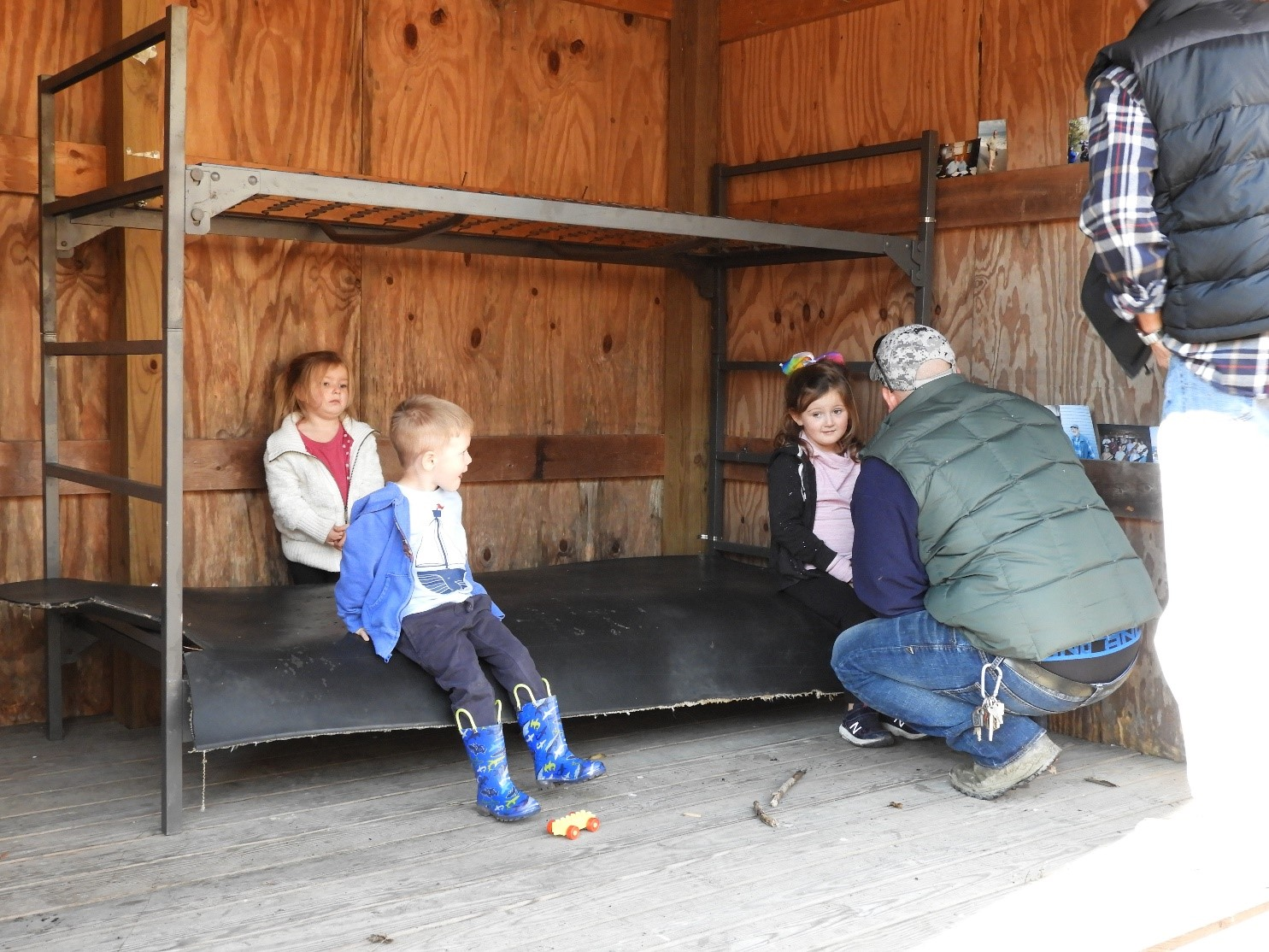 Grandchildren and Great Grandchildren try out the bunk bed donated by the Weiford family and placed in the Reger family shelter by Giles Wright and Greg Edwards.