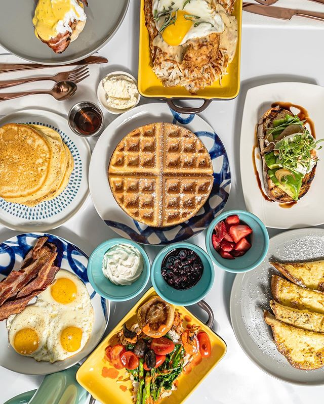 What's your favorite brunch item on this table? 🤤🥓🥞🍳🍔