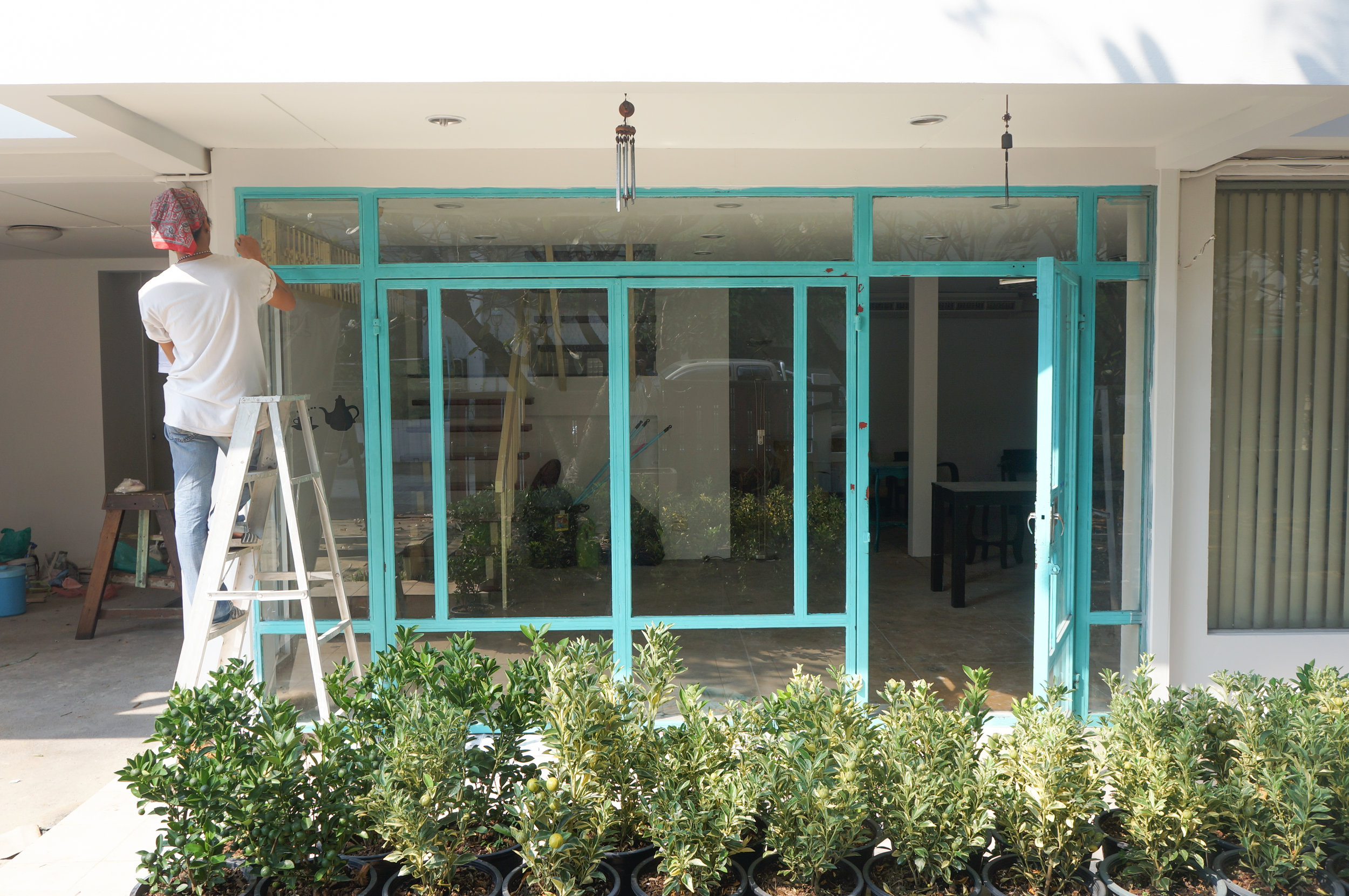 Blue Door Creative Space: Painting the windows