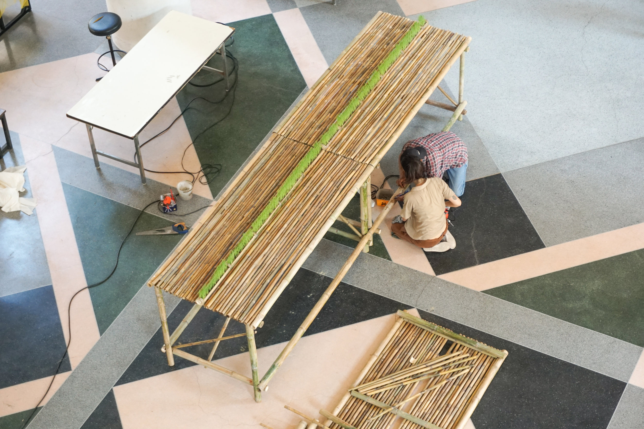 City Farming for a Sustainable City Event: Building a big bamboo table with a roll of micro greens