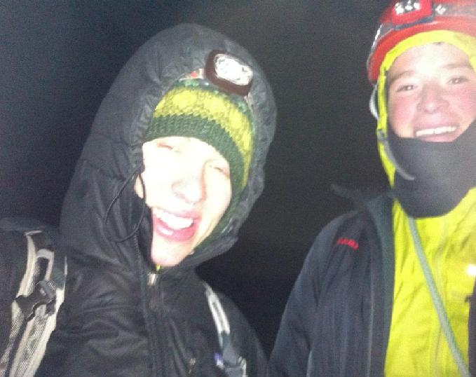 Kirill and Colin on the summit, struggling to stay warm (and grow facial hair)