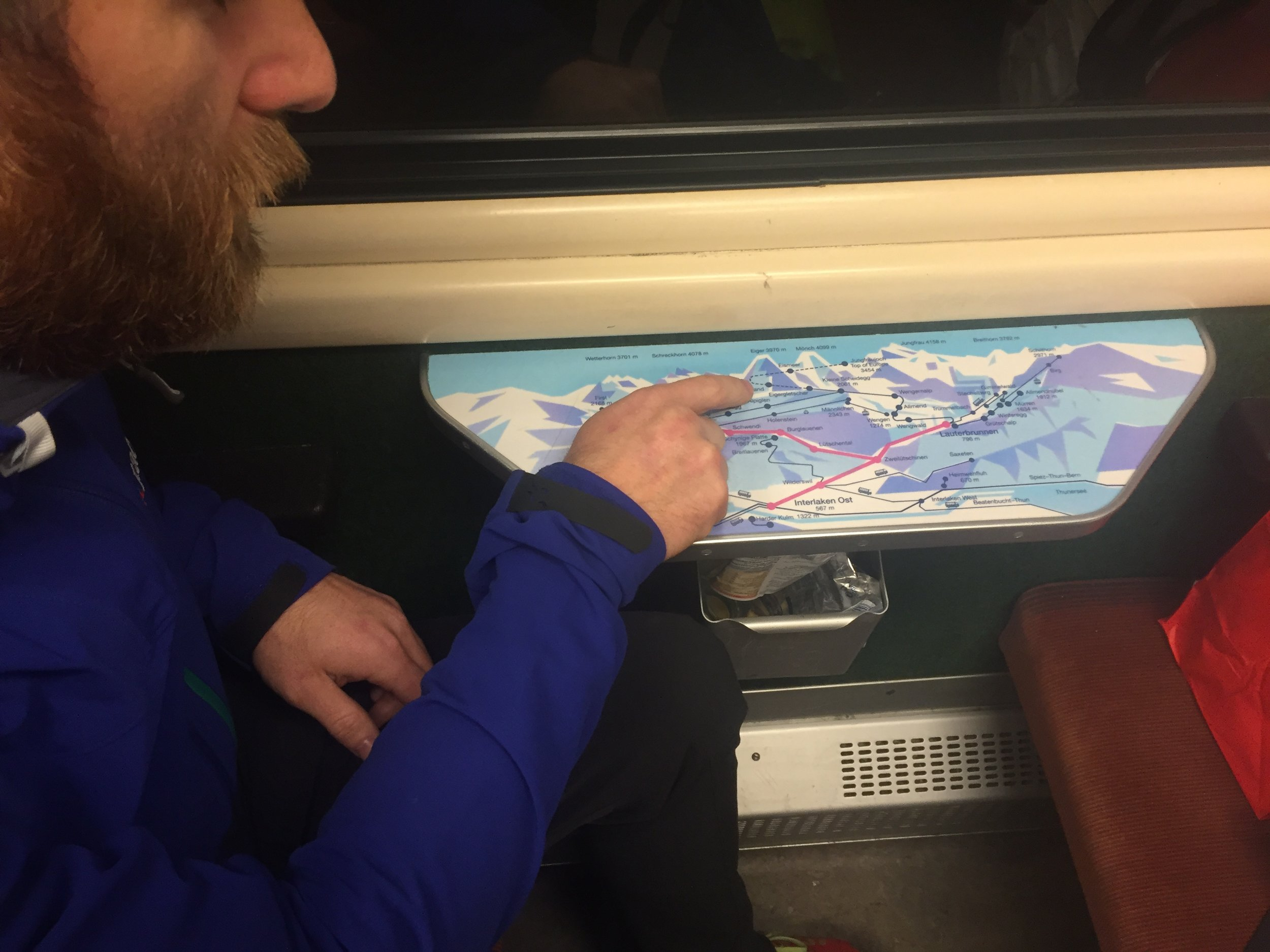 Jed pointing out our route, on the handy cartoon map table on the train to Kleine Scheidegg.