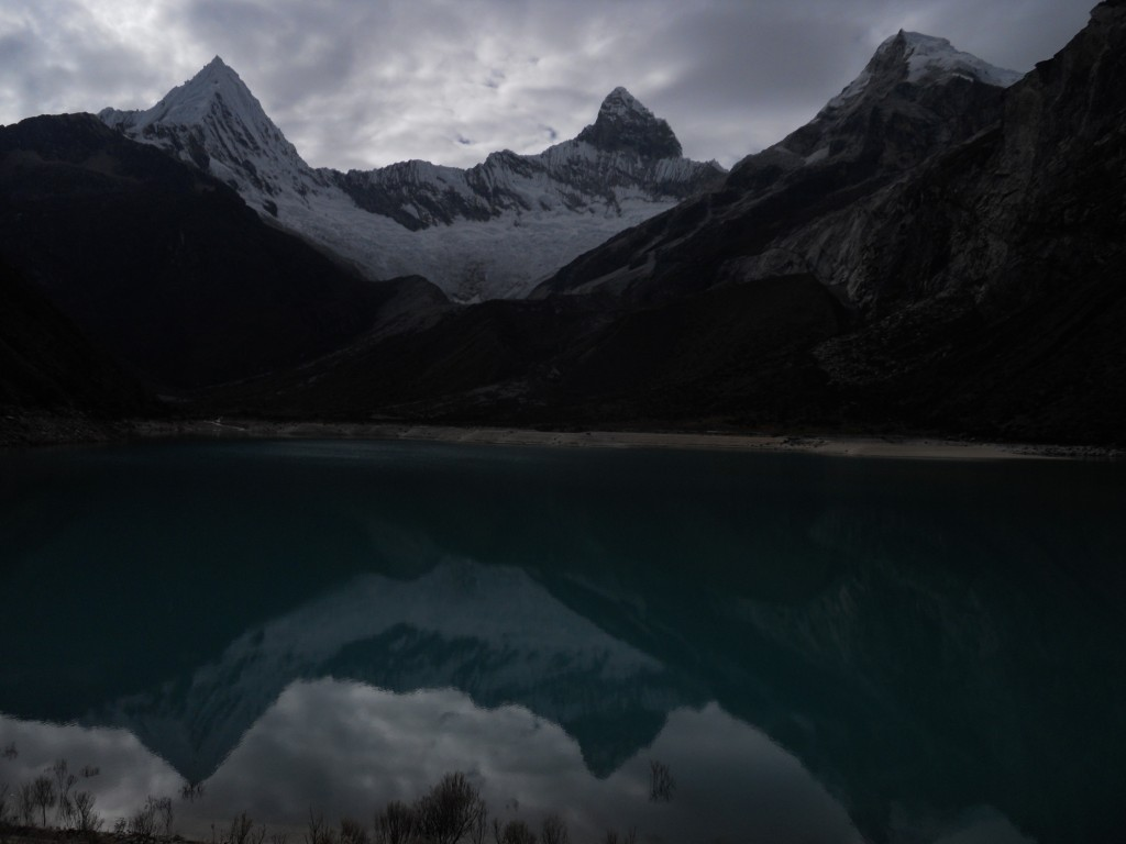 Piramide on the left, and Chacraraju Oeste on the right, reflected in Laguna Paron