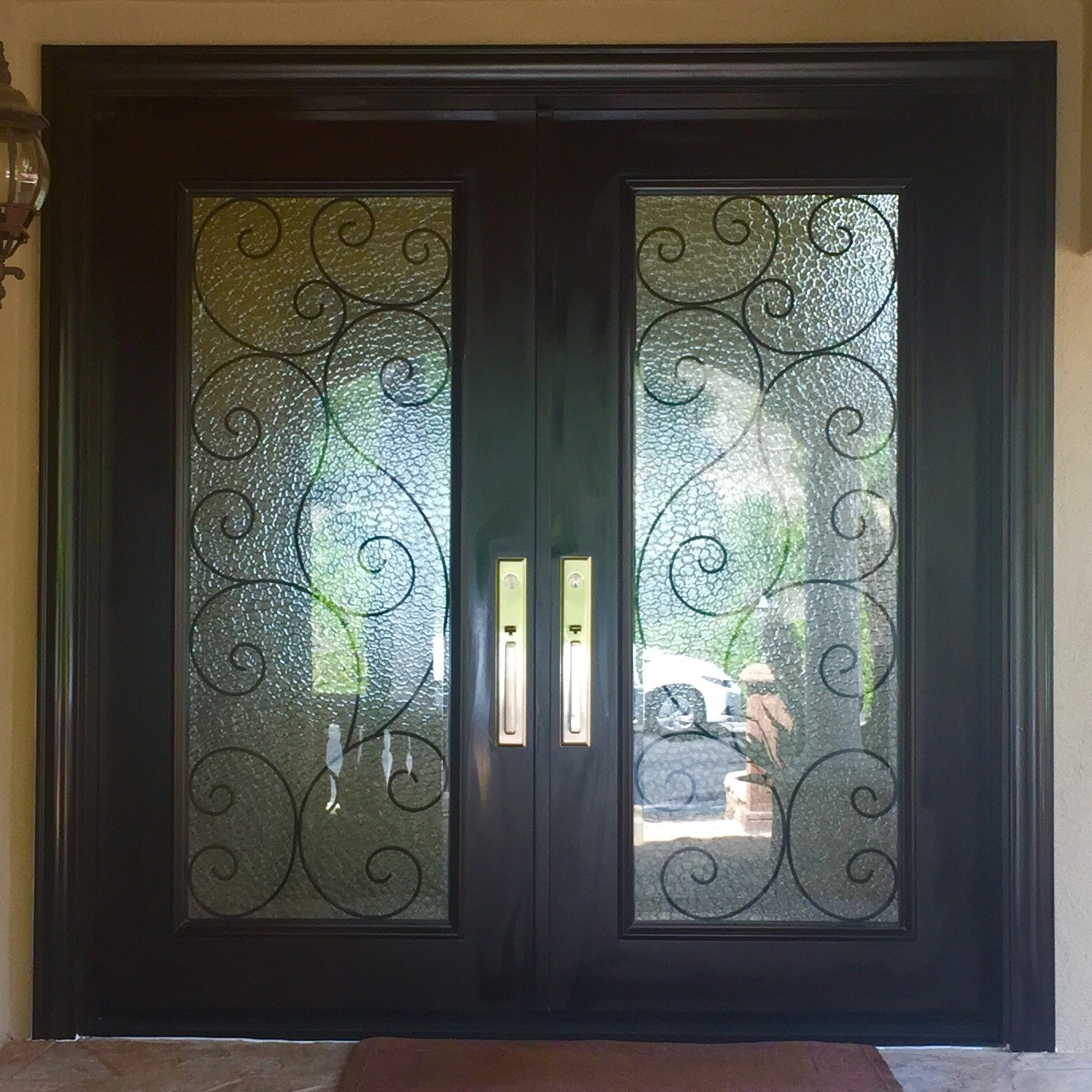 0029 - Custom mahogany rustic double entry doors with Flemish glass and iron