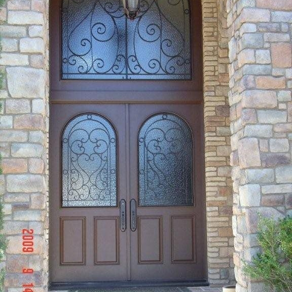 0078 - Custom rustic accoya single entry door with iron and transom