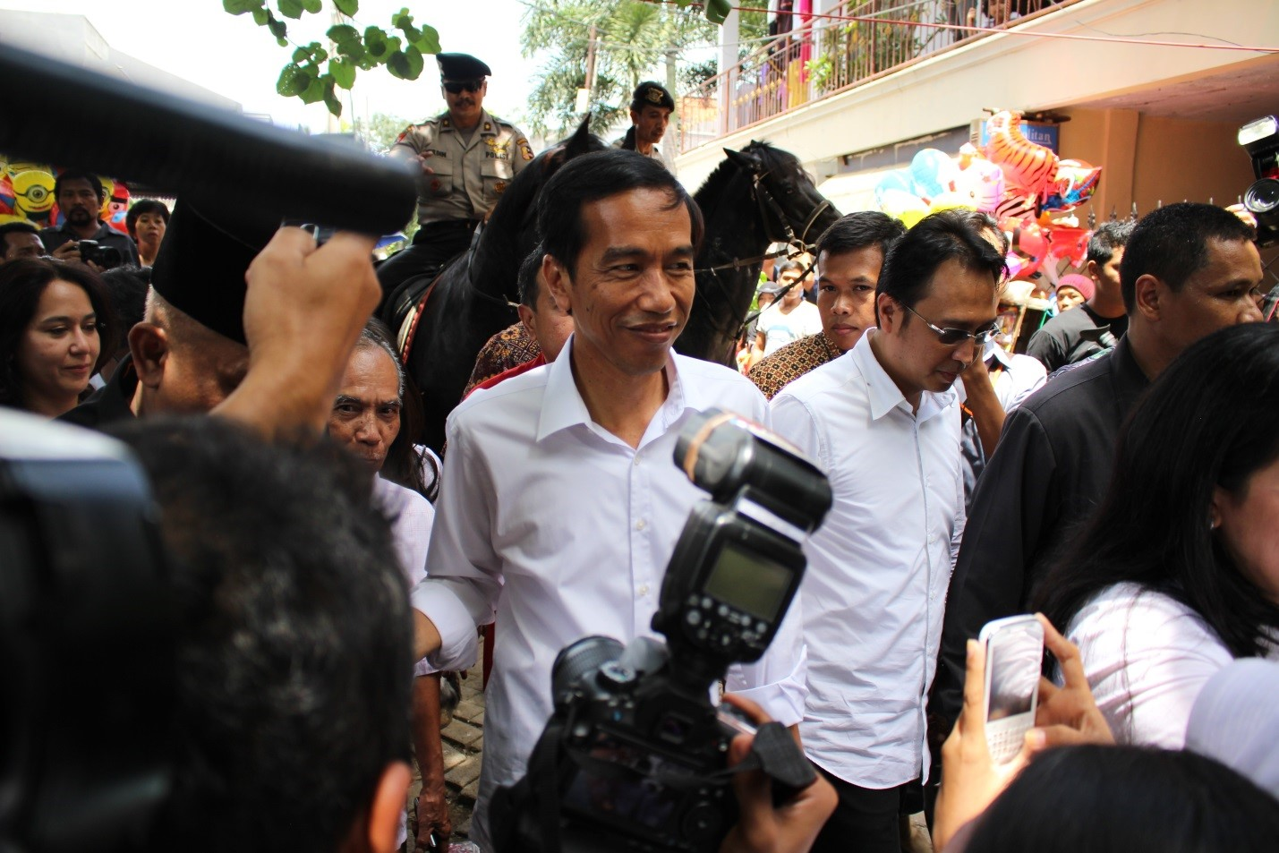 © Photo of (then not-yet President ) Joko Widodo during balloting for Legislative Elections, taken by M.P.Stadler, 9 April 2014