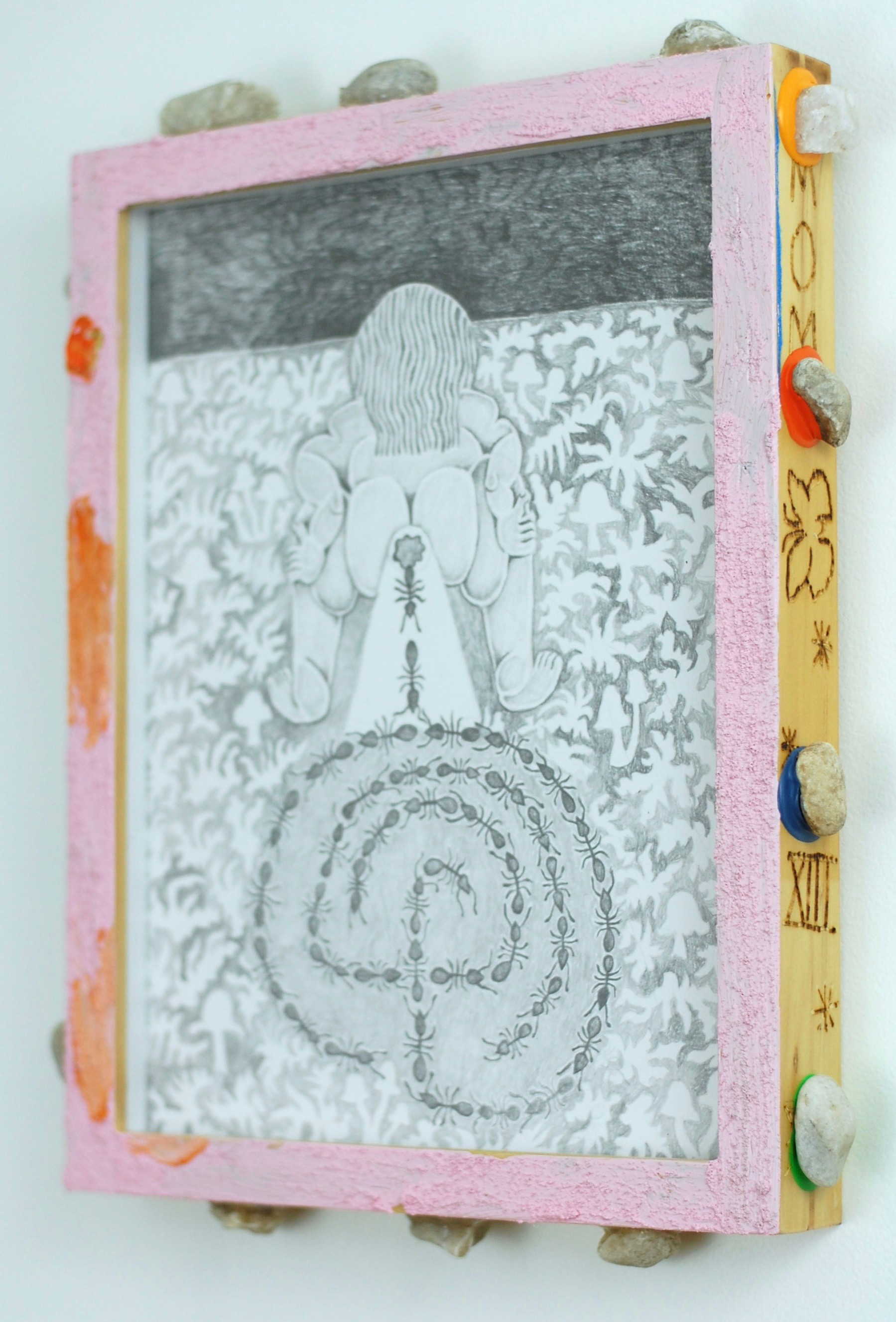 I walked the walls and not the labyrinth . 2018. Graphite on paper with acrylic, pumice, pebbles from back yard, and heat carving on wooden frame. 9x12in.