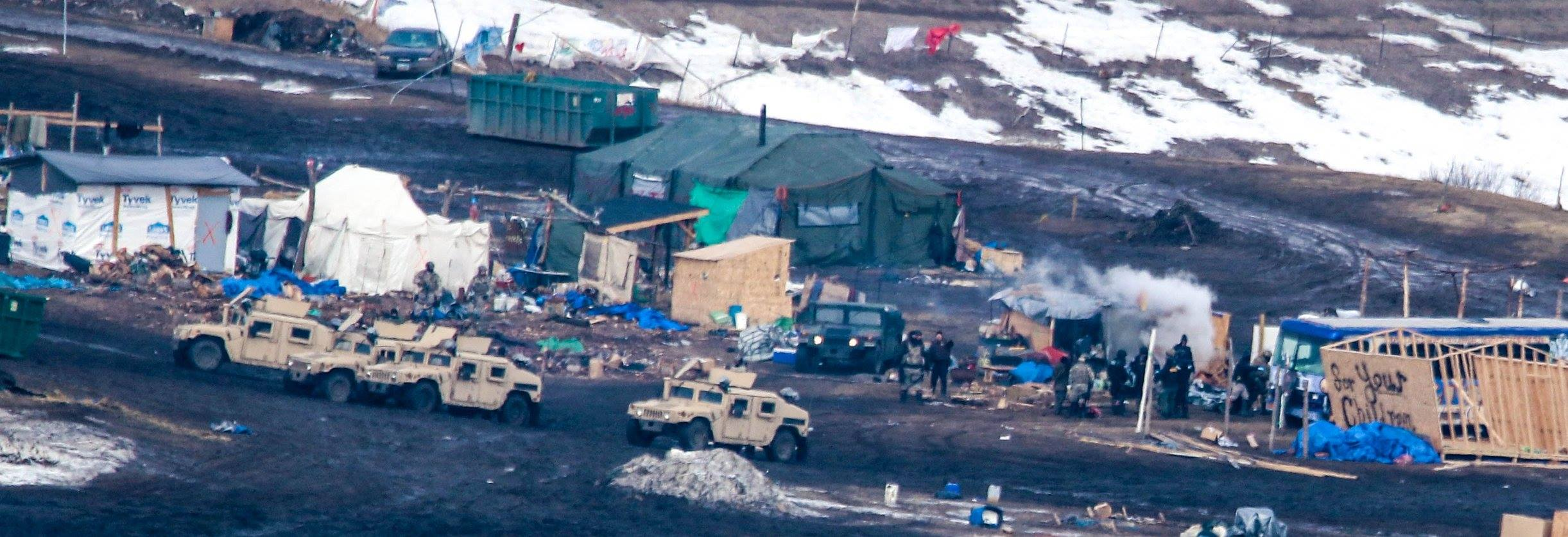 Evacuation Oceti Sakowin Camp, Law Enforcement Agents Extinguishing the Sacred Fire - February 23rd, 2017 - By MK