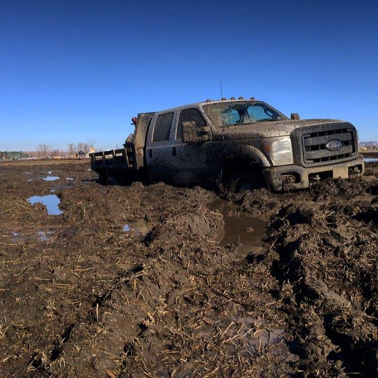 February 20th, 2017 - Vehicles were getting stuck in multiple places all over the camp, sometimes having to be pulled out two or three times. Oceti Sakowin Camp - MK