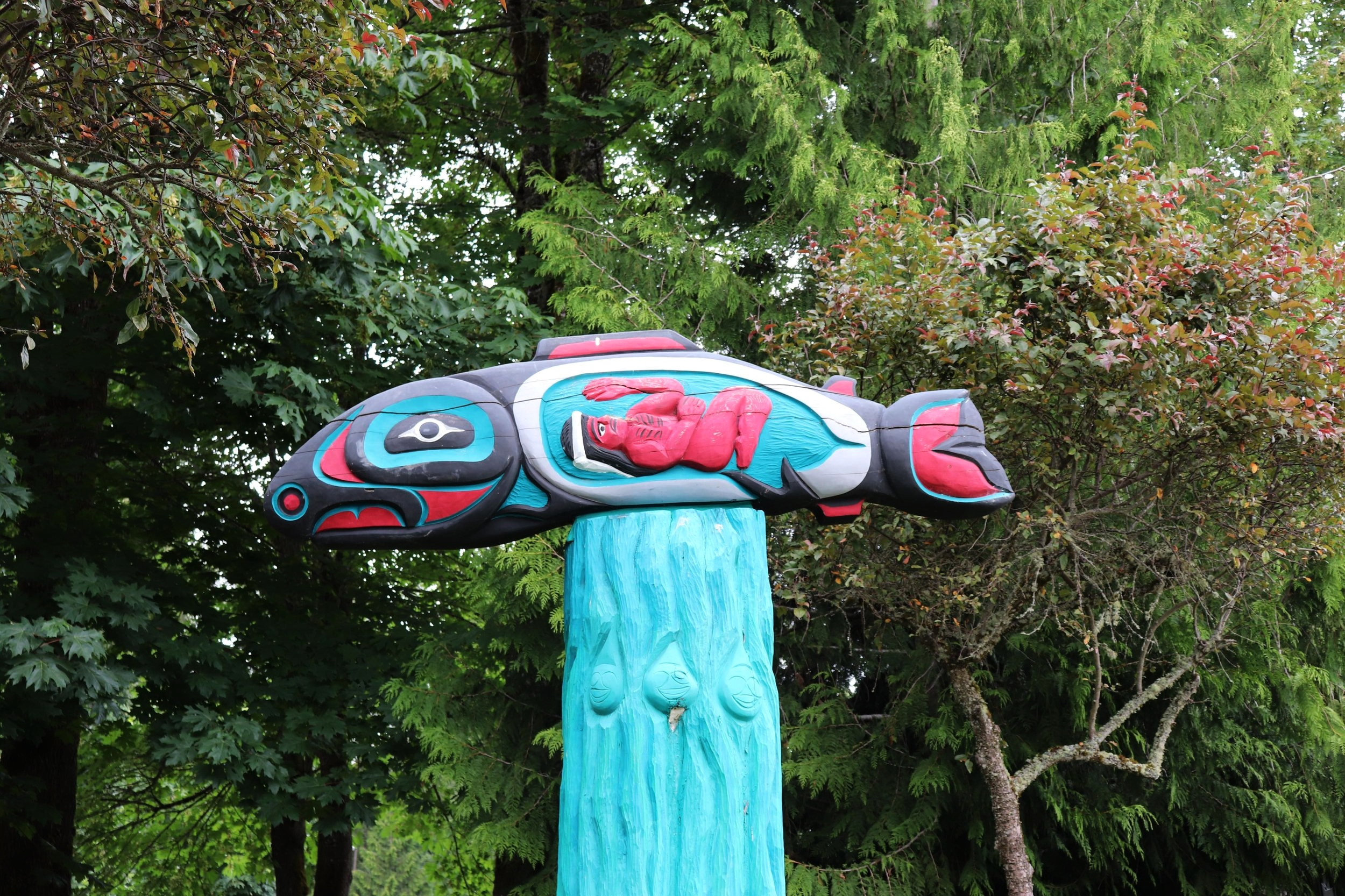 Totem on the grounds at Wa He Lut Indian School, Frank's Landing.    The school is located near the apex of the Nisqually delta and estuary, which adjoins the Puget Sound. The name, Wa He Lut, comes from a Nisqually warrior and medicine man whose power flowed from thunder and lightning. Wa He Lut Indian School was founded in 1974 by T. Maiselle Bridges and members of the Frank's Landing Indian Community. Their vision for the school was to ensure that Native American children would get funding for the education they were promised in the Medicine Creek treaty.