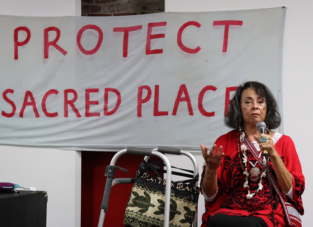 We were blessed with the prayers and teachings of grandma Gloria Arellanes,a Tongva leader in Los Angeles. She made us aware of the devastation occurring in the Bolsa Chica region, a land long stewarded by the Tongva, where many of their ancestors' graves have been disrupted by expansion, occupation, and gentrification.